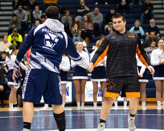 Raymond Christas of Dallastown (left) and Michael Wolfgram of Central York (right) shake hands as their weight class is announced during the wrestling dual meet at Dallastown Area High School, Thursday, January 3, 2019. The Wildcats defeated the Panthers 62-18.