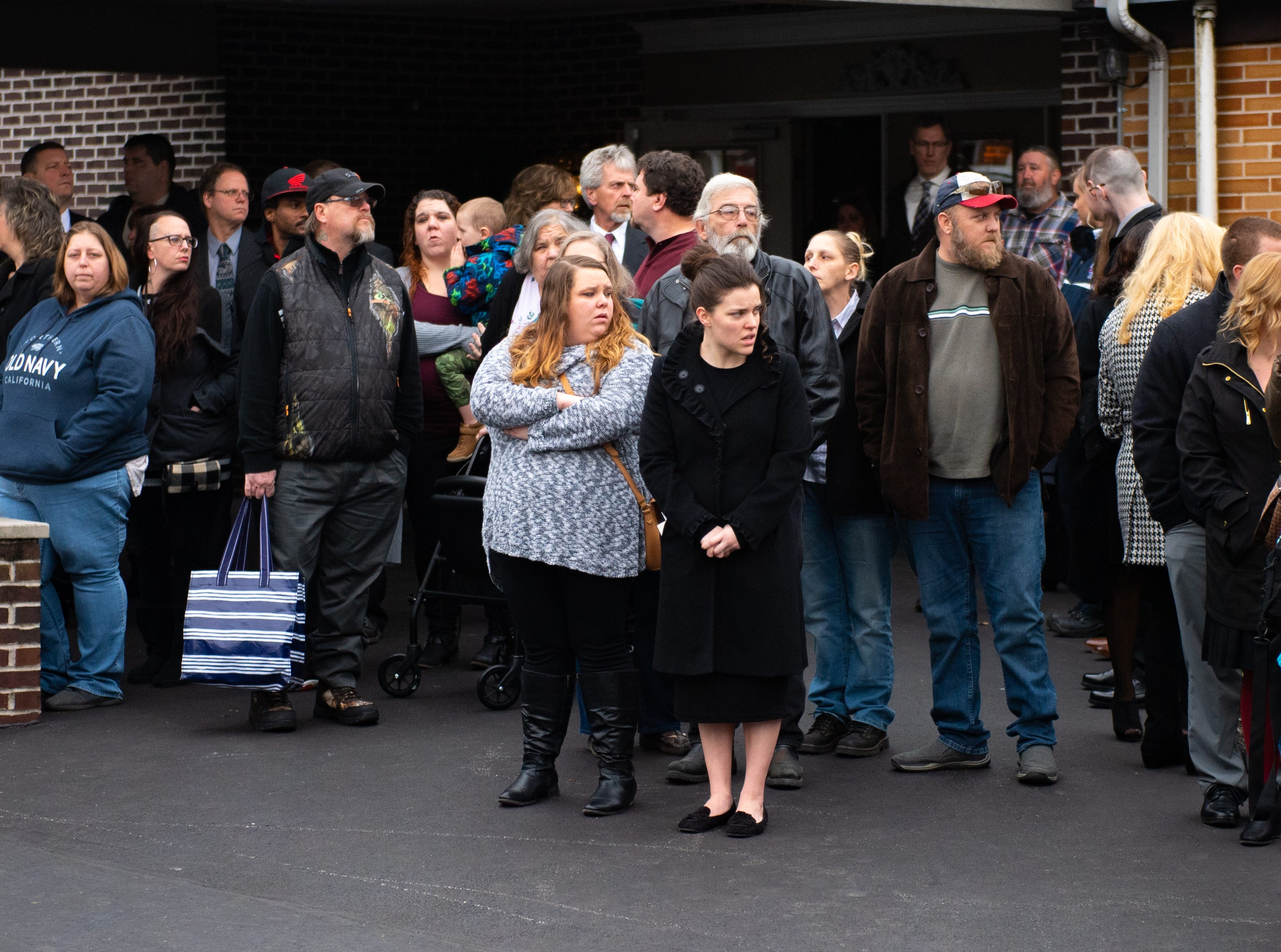 Friends and family see off the ambulance carrying Robert Kohler Sr. It's his last ride, January 4, 2019.
