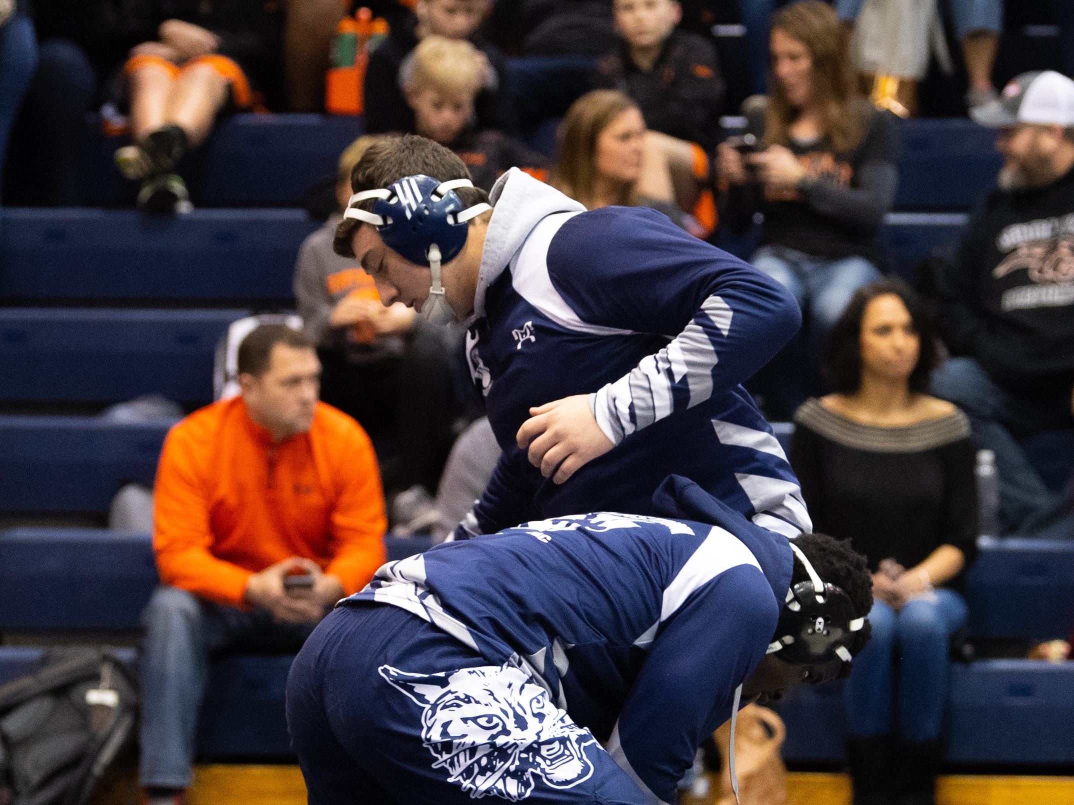 Raymond Christas (top) and Jamal Brandon (bottom) of Dallastown practice their techniques before taking on Central York, Thursday, January 3, 2019. The Wildcats defeated the Panthers 62-18.