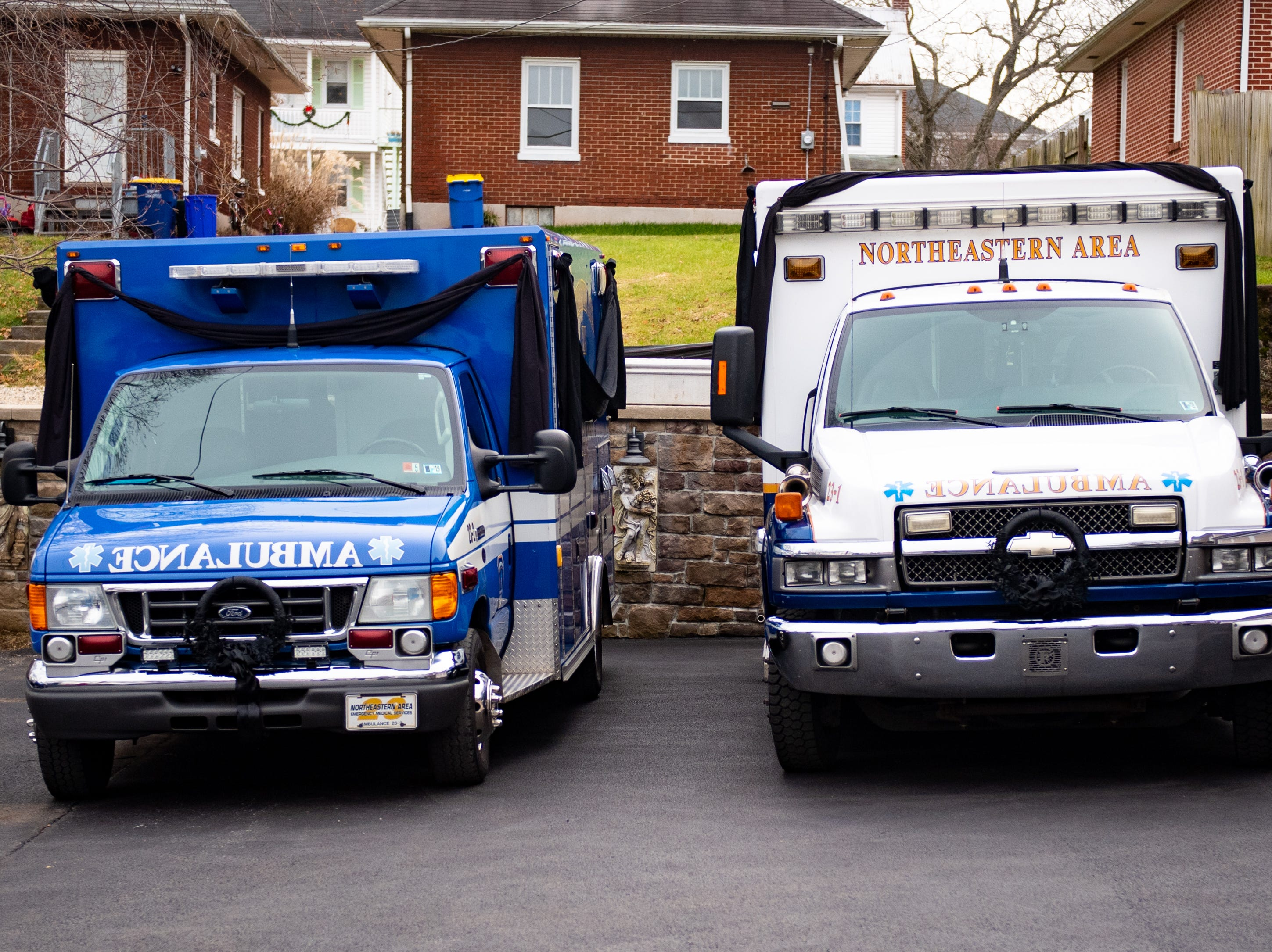 These two ambulances were used for Robert Kohler Sr.'s last ride. He rode in the white ambulance, while his family rode in the blue one, January 4, 2019.