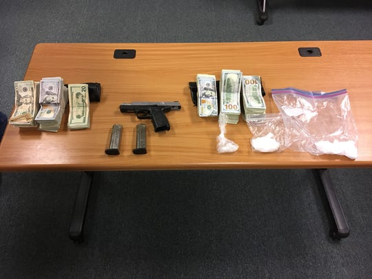 Cash, cocaine, methamphetamine and a loaded firearm were confiscated.