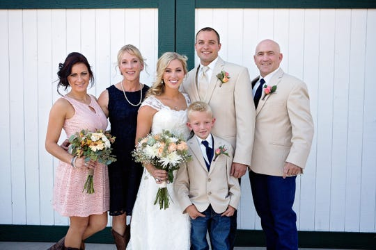 Kelly Cass, far left with her family Cristie Cass, Kayla Dowty, Caden Dowty, Cole Dowty and Ken Cass at a wedding in 2014.