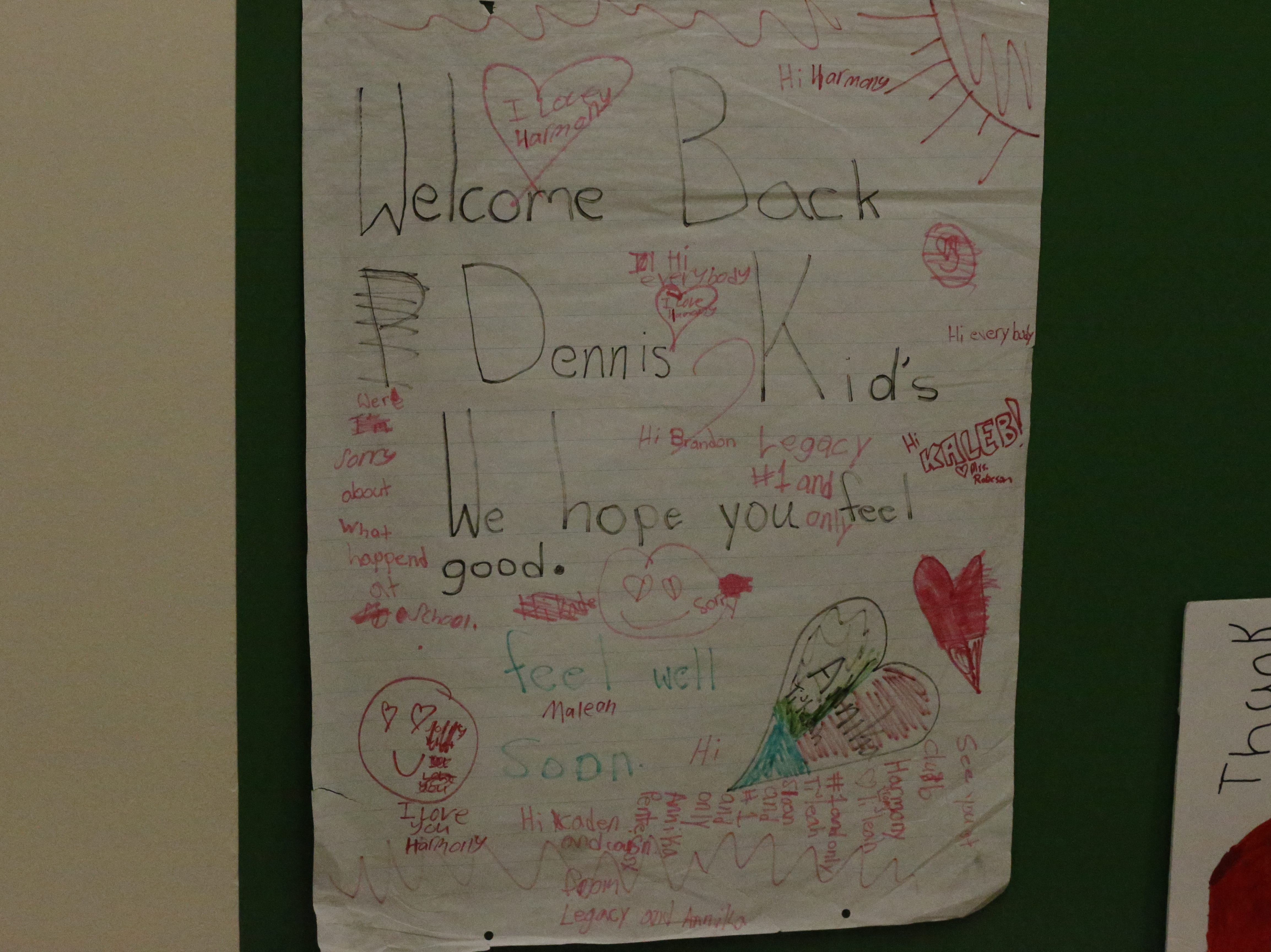 Signs of support hang in the hallway outside the cafeteria at Dennis Intermediate School on Friday, Jan. 4.