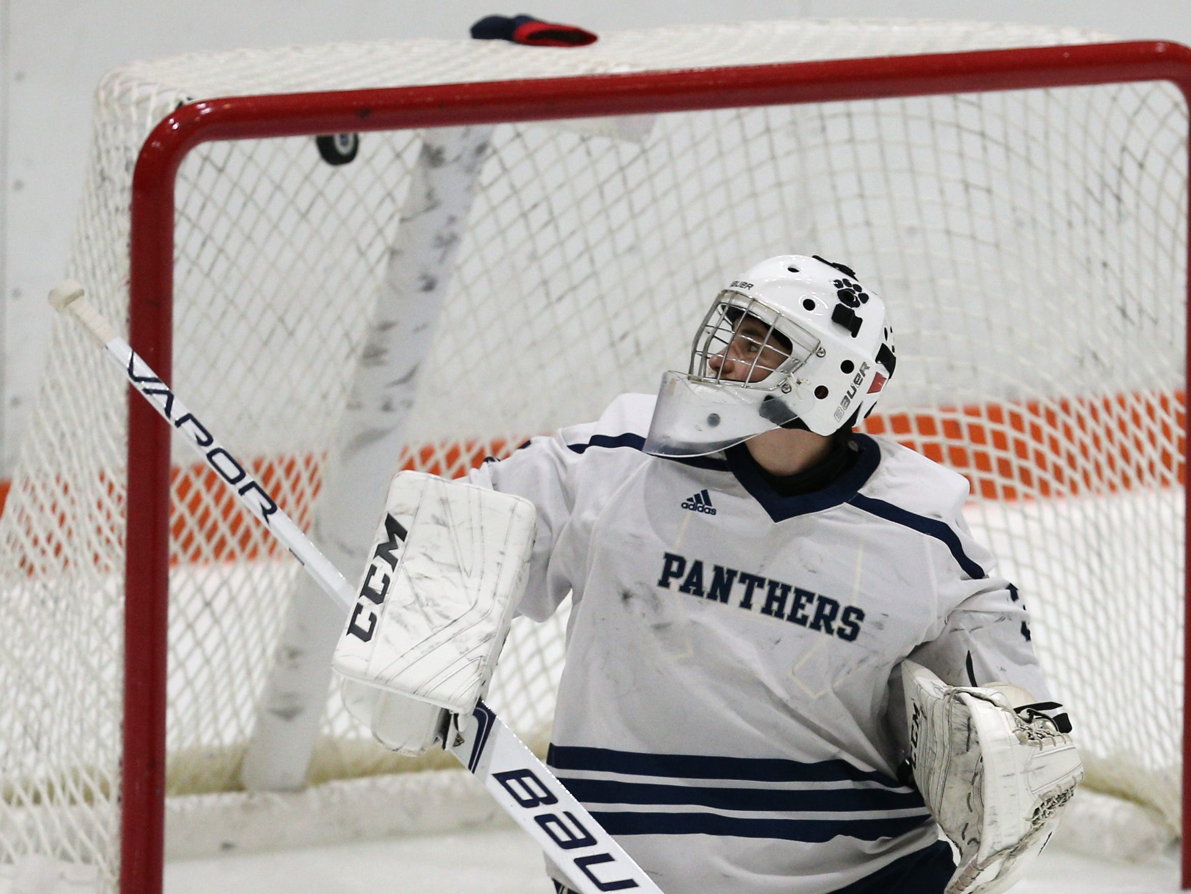 Pittsford's Alex Tidd (33) watches Hilton's first goal hit inside the top of the net.