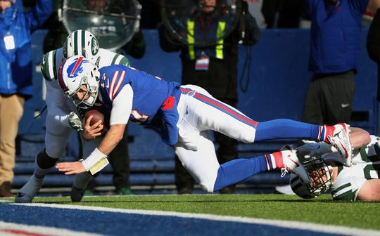 Bill quarterback Josh Allen scores on this six-yard run in the first quarter against the New York Jets on Dec. 9.