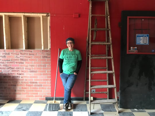 Jennifer Johnson, owner of Misfit Doughnuts, poses in the space next door to her Monroe Avenue shop.
