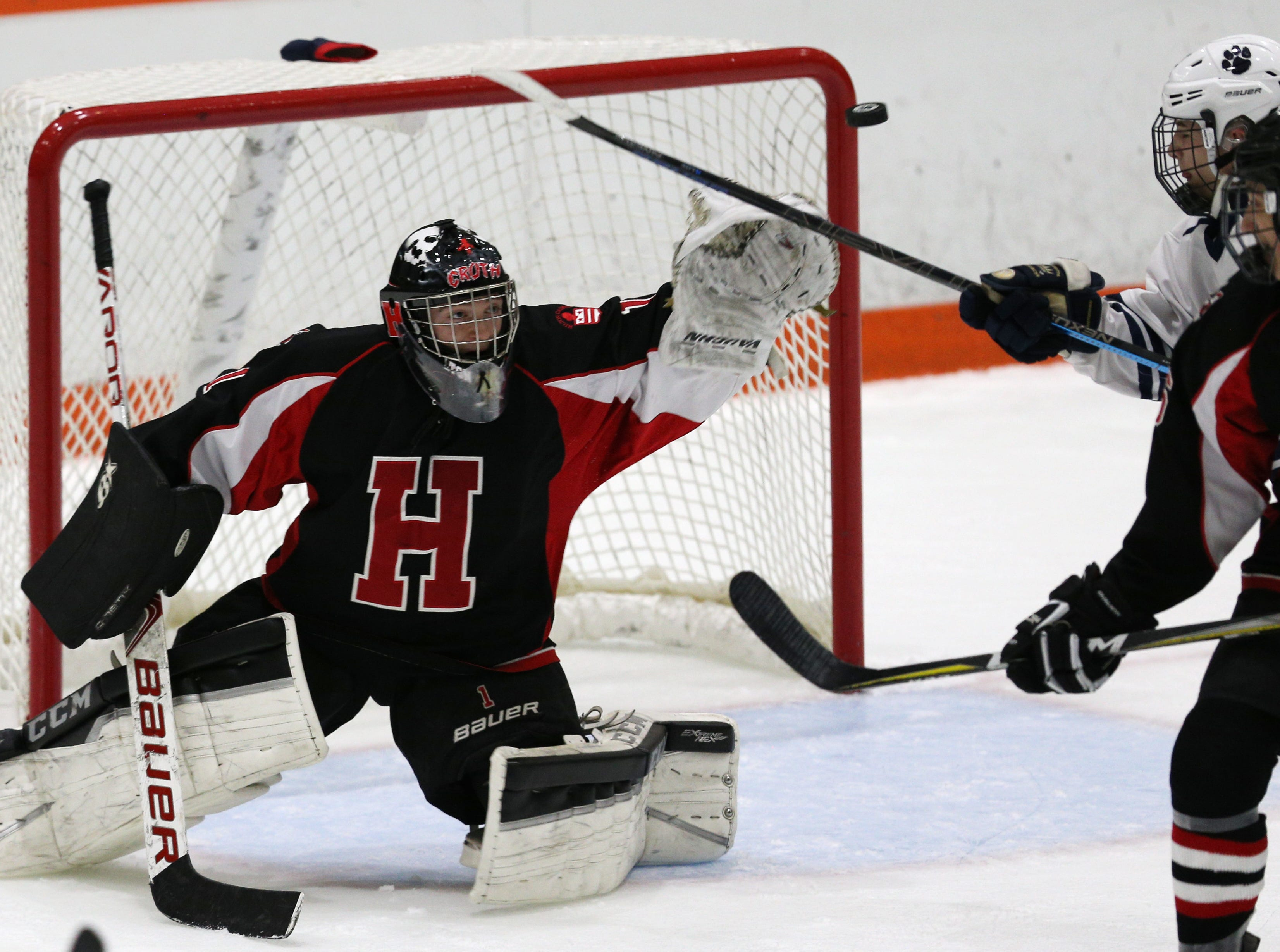 Hilton's Christian Roth (1) makes a save against Pittsford.