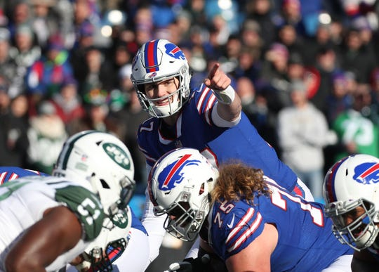 Bills quarterback Josh Allen sets the play at the line of scrimmage against the Jets.