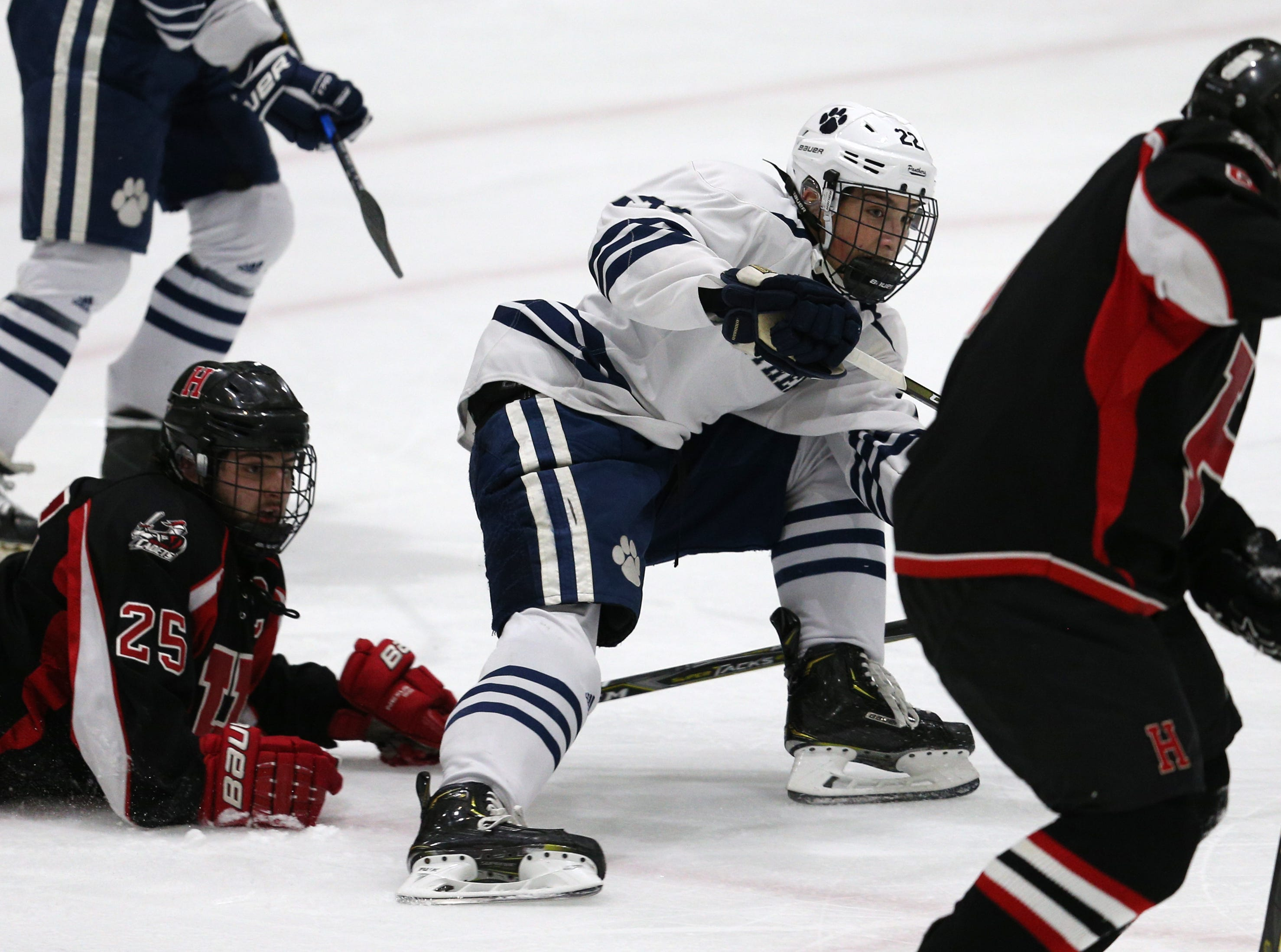 Pittsford's Will Masaschi (22) looks to get the puck into Hilton territory.