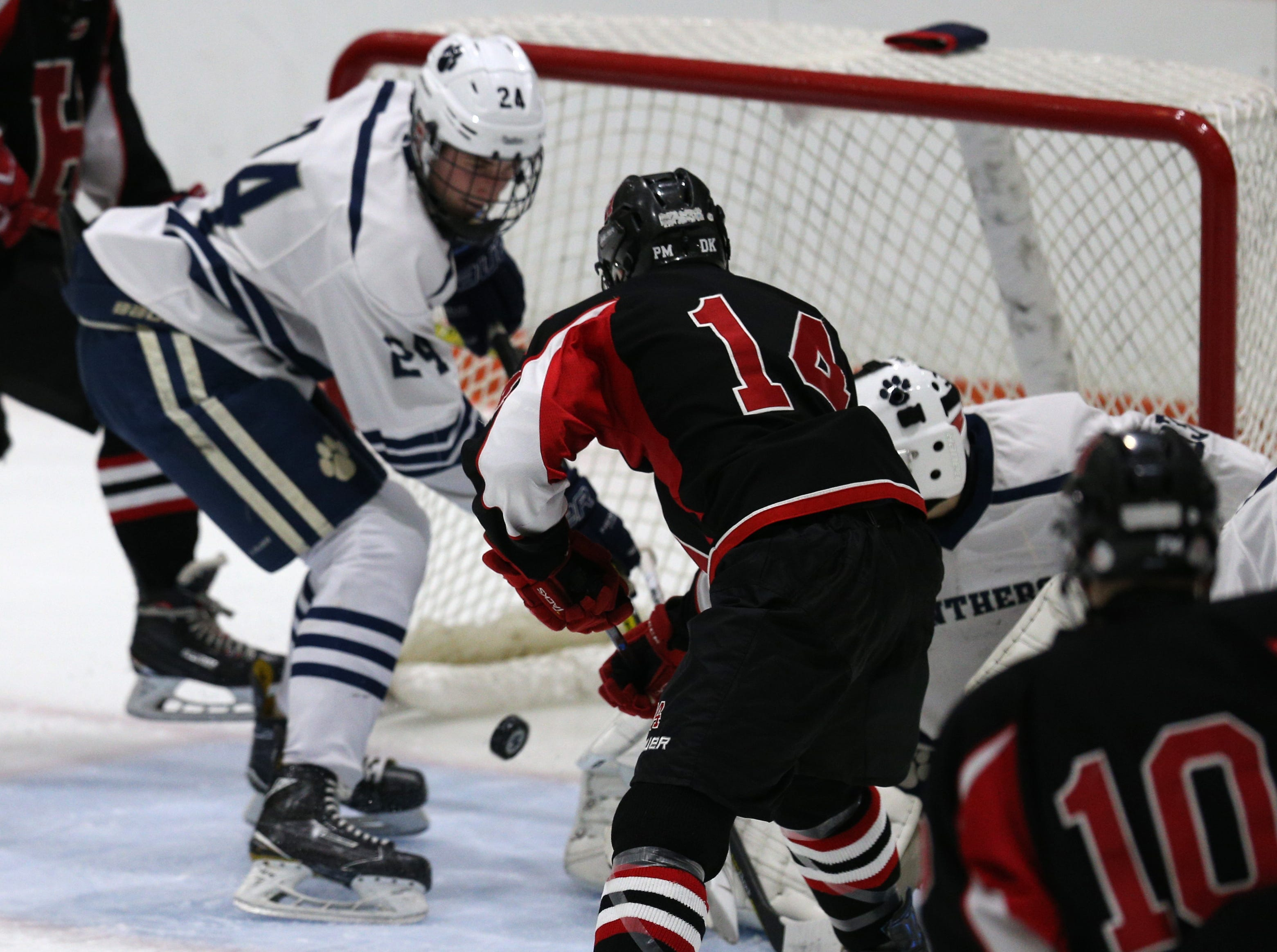 Hilton's Jake Lantz (14) watches his shot go in for a goal against Pittsford.