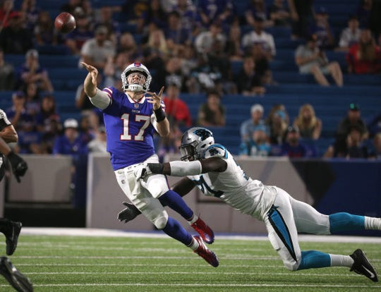 Bills rookie quarterback Josh Allen makes an off balance throw as he is pressured by Efe Obada in a 28-23 to the Carolina Panthers in the preseason.
