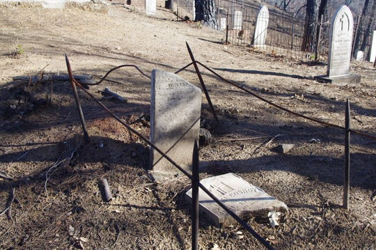 Some of the headstones in the Catholic Cemetery at Shasta State Historic Park were damaged during the Carr Fire.