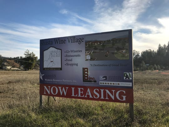 A sign marketing space sits on the site of the Shasta Wine Village. It's been nearly five years since a ceremonial groundbreaking was held.