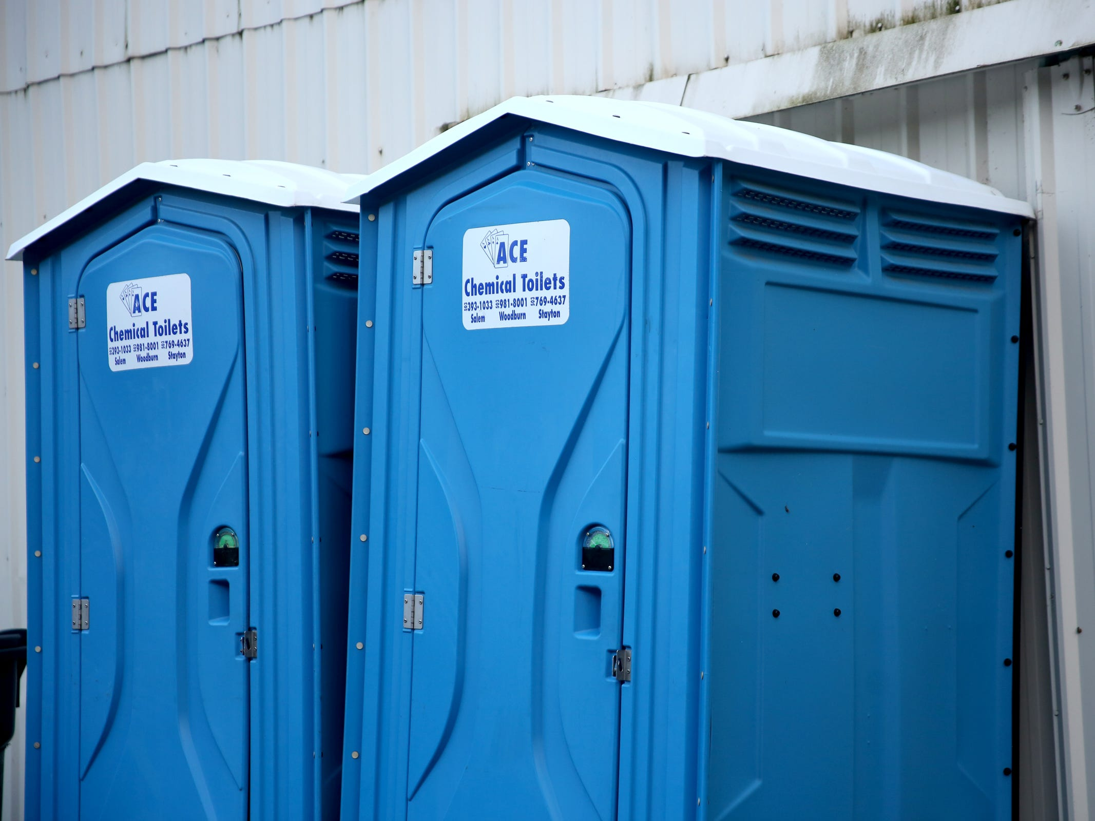 Port-a-potties near Mountain High Grocery in Detroit on Thursday, Jan. 3, 2019. The city has no sewer system, and residents and businesses rely on septic systems, many of which are in need of replacement.