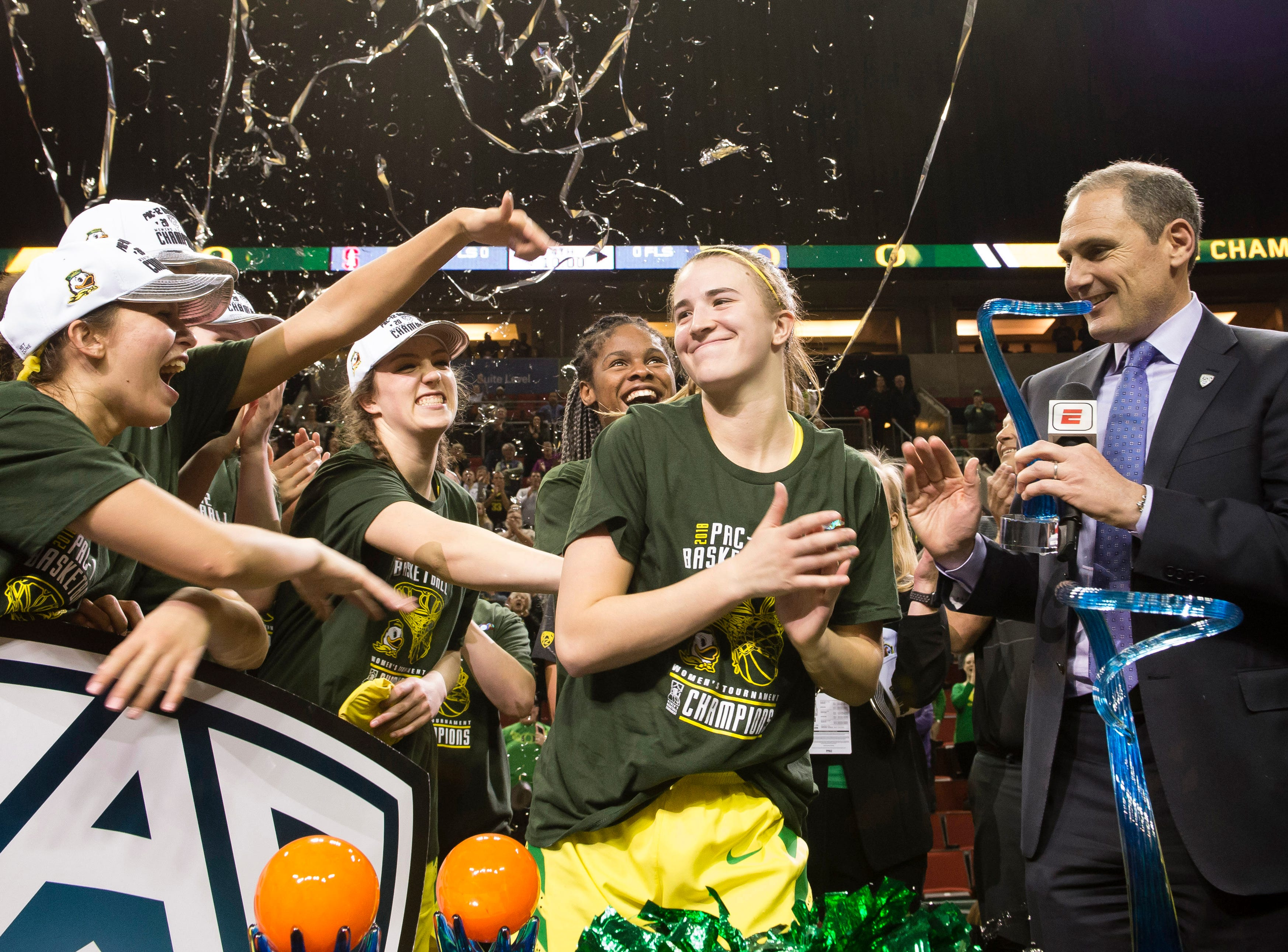 Mar 4, 2018; Seattle, WA, USA; Oregon Ducks guard Sabrina Ionescu (20) celebrates with teammates after receiving the Most Outstanding Player award during a celebration following a game against the Stanford Cardinal at the championship game at the Pac-12 Women's Basketball Tournament at KeyArena. The Ducks won 77-57. Mandatory Credit: Troy Wayrynen-USA TODAY Sports