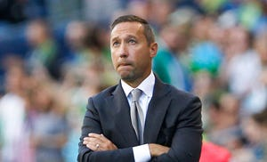 Portland Timbers head coach Caleb Porter stands on the sideline during the first half against the Seattle Sounders FC at CenturyLink Field in 2017.