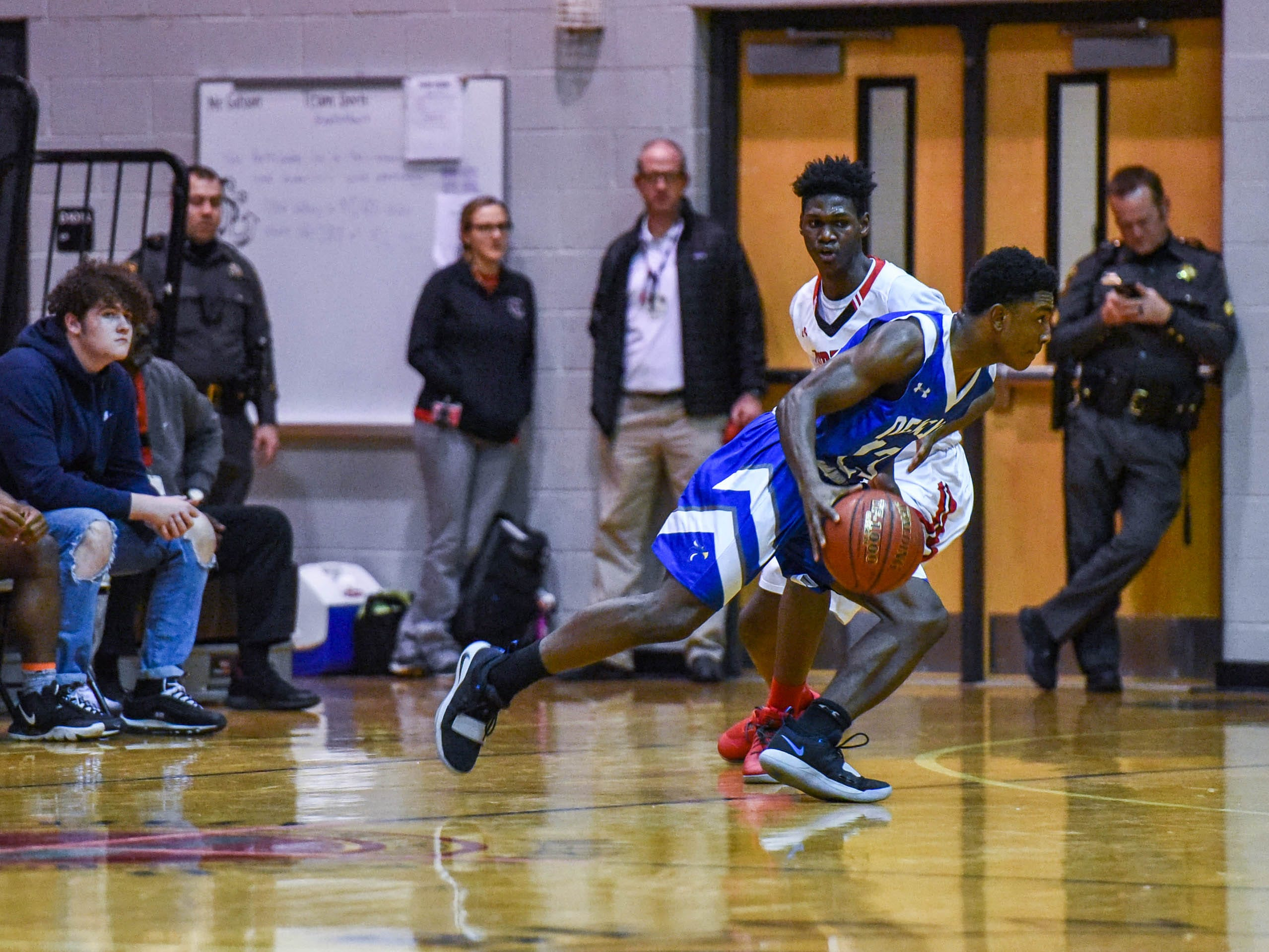 Decatur's London Drummond (23) moves the ball during a game against Bennett at Bennett High School in Salisbury on Thursday, Jan 3, 2018.