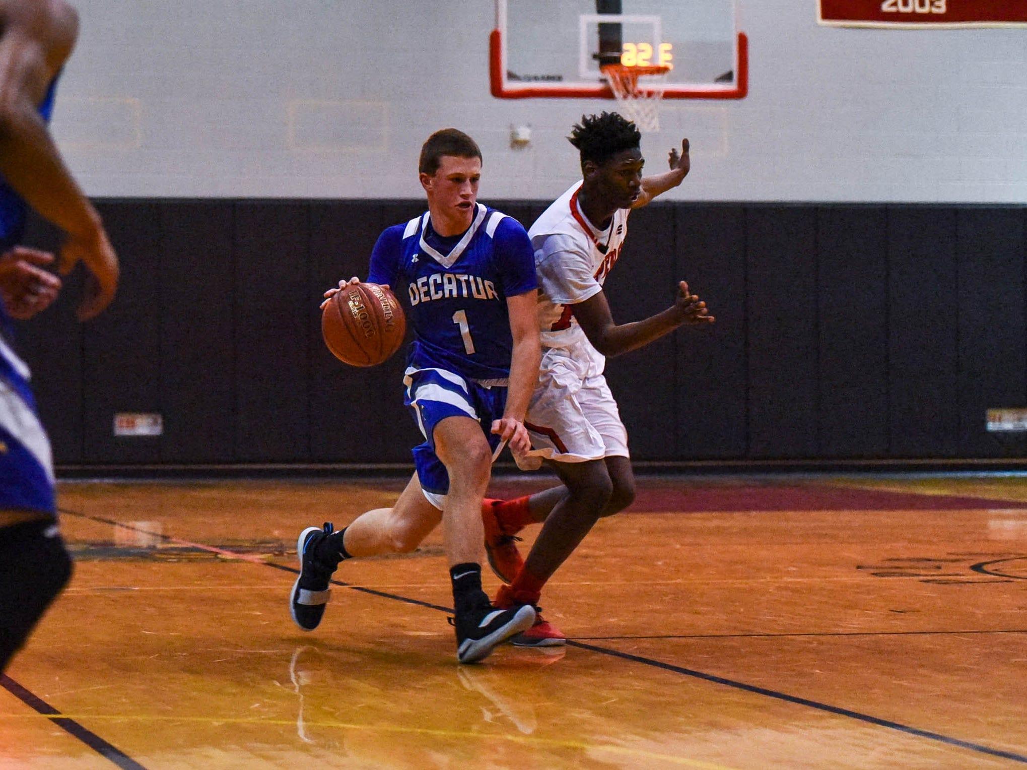 Decatur's Drew Haueisen (1) moves the ball during a game against Bennett at Bennett High School in Salisbury on Thursday, Jan 3, 2018.
