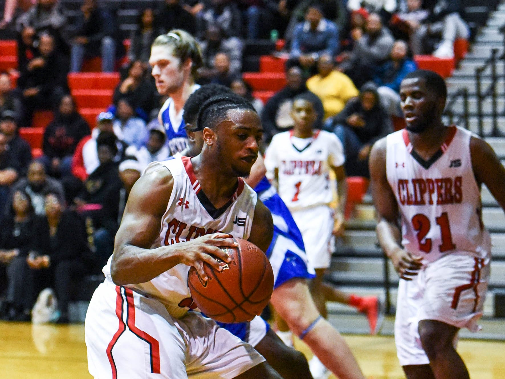Bennett's Saquan Cotton (3) moves the ball during a game against Decatur at Bennett High School in Salisbury on Thursday, Jan 3, 2018.