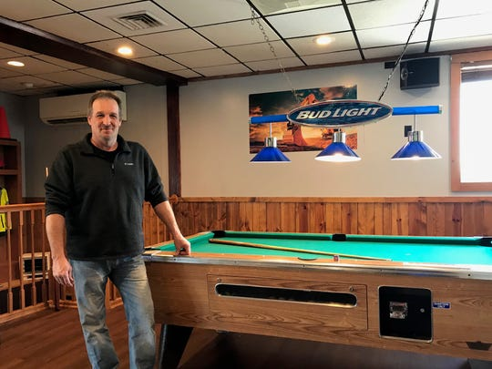 Work Zone Bar and Grill owner Curt Hinz with the new pool table installed as part of a remodel of Jake's Roundabout Steakhouse. The new Work Zone restaurant opened on Friday. Hinz hopes to create a more inviting and casual meeting space.
