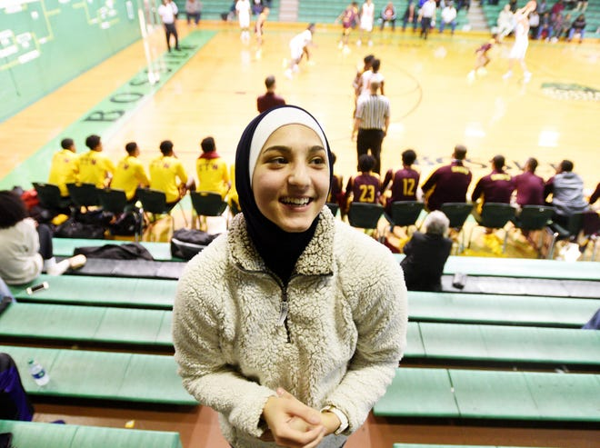 Airline's Anwaar Shihadeh, who began wearing her hijab during games this season, is a standout on the Lady Viking's basketball team.