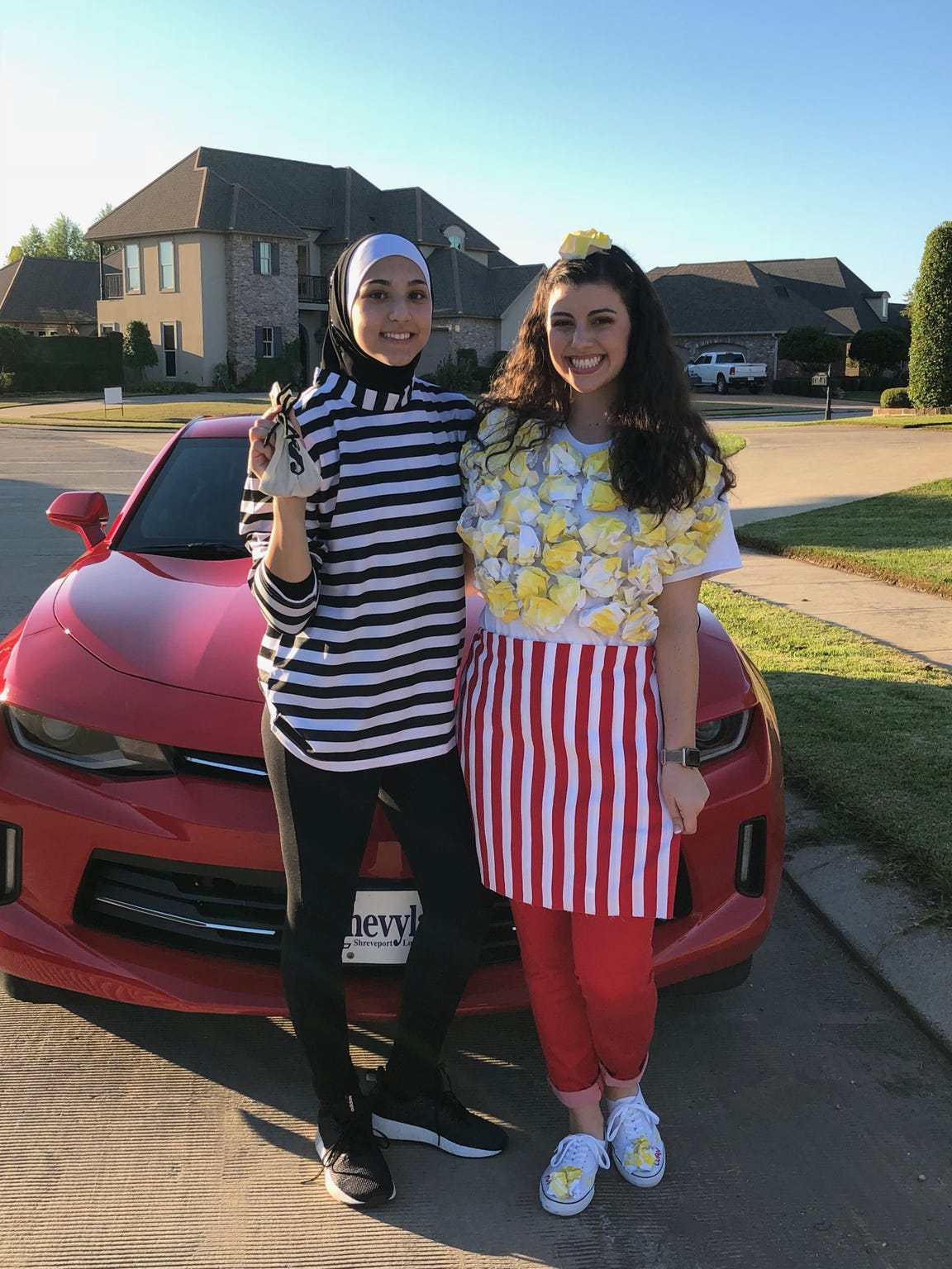 Airline's Anwaar Shihadeh and Emily Bourgeois pose prior to their Halloween party last fall.