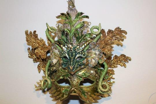 A dragon head mask crafted by Fantasy Mask Designer Dennis Beckman.
