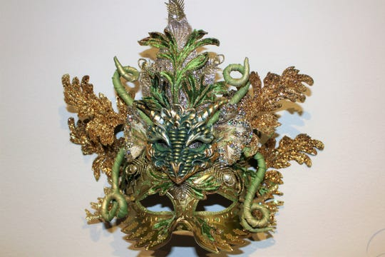 A dragon head mask crafted by Fantasy Mask Designer Dennis Beckman.