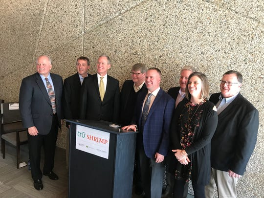 Outgoing South Dakota Gov. Dennis Daugaard poses for a portrait with company leaders of Trū Shrimp, an aquaculture shrimp maker. The company announced its first production facility in Madison.