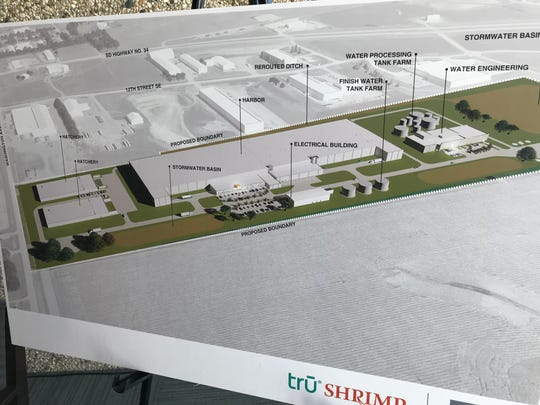 A poster-board rendering shows where the Tru Shrimp facility will be located on Washington Avenue near 12th Street Southeast in Madison.
