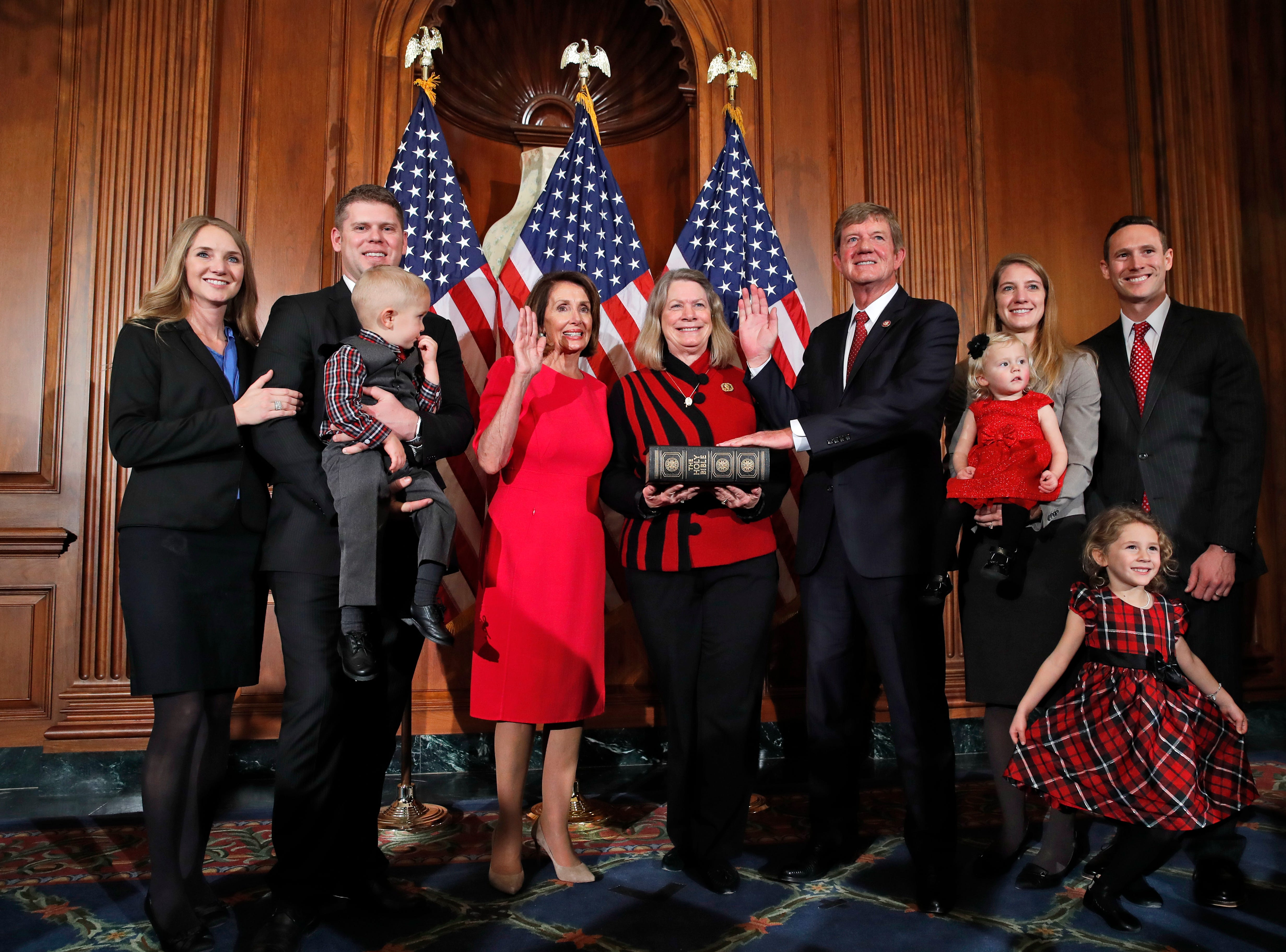 House Speaker Nancy Pelosi of Calif., left, poses during a ceremonial swearing-in with Rep. Scott Tipton, R-Colo., third from right, on Capitol Hill, Thursday, Jan. 3, 2019 in Washington during the opening session of the 116th Congress.. (AP Photo/Alex Brandon)
