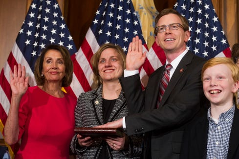 "House Speaker Nancy Pelosi of California poses during a ceremonial swearing-in with Rep. Dustin ""Dusty"" Johnson, R-S.D., on Capitol Hill in Washington on Jan. 3."