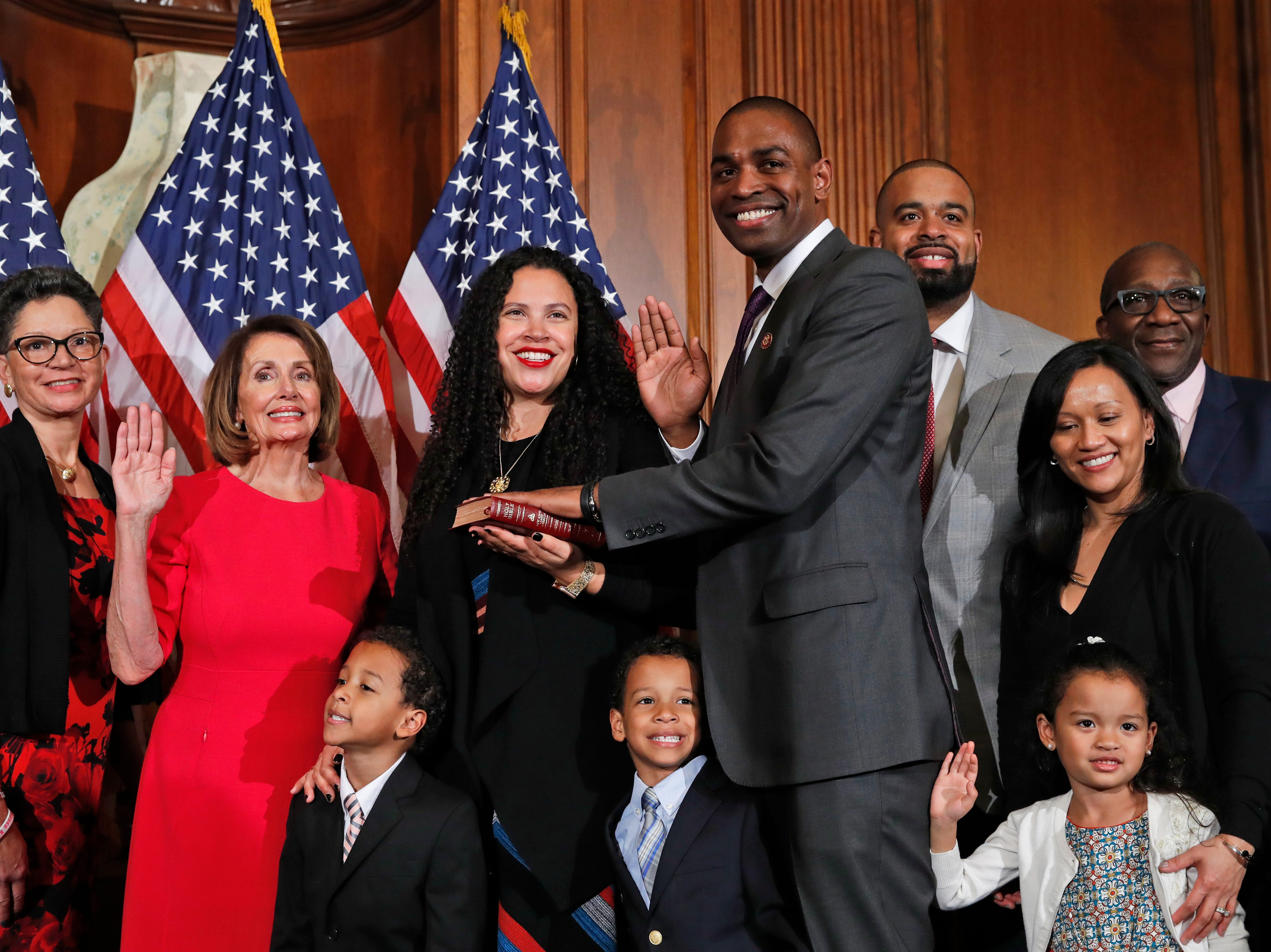 House Speaker Nancy Pelosi of Calif., left, poses during a ceremonial swearing-in with Rep. Antonio Delgado, D-N.Y., right, on Capitol Hill, Thursday, Jan. 3, 2019 in Washington during the opening session of the 116th Congress.. (AP Photo/Alex Brandon)