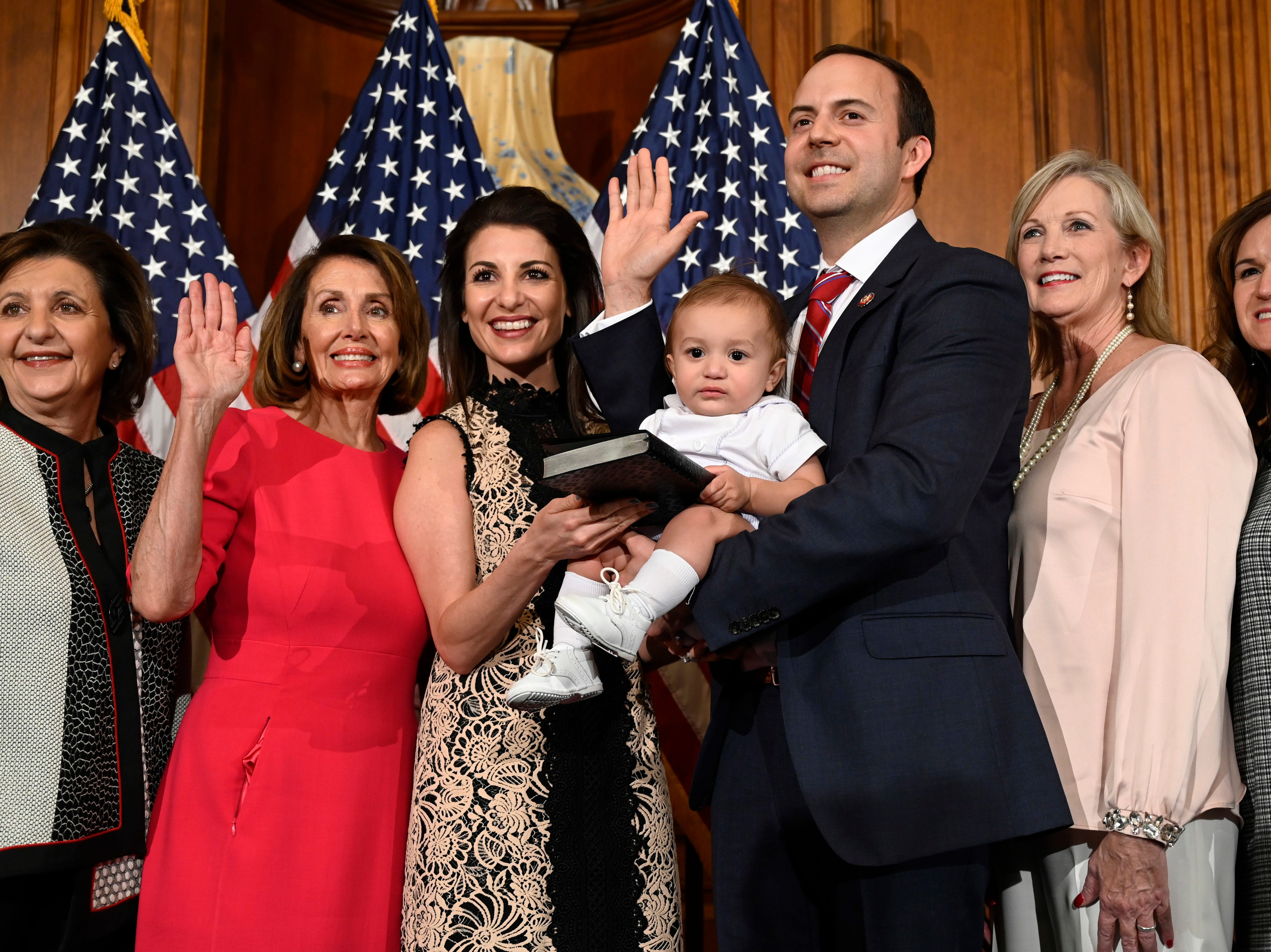 House Speaker Nancy Pelosi of Calif., second from left, poses during a ceremonial swearing-in with Rep. Lance Gooden, R-Texas, third from right, on Capitol Hill in Washington, Thursday, Jan. 3, 2019, during the opening session of the 116th Congress. (AP Photo/Susan Walsh)