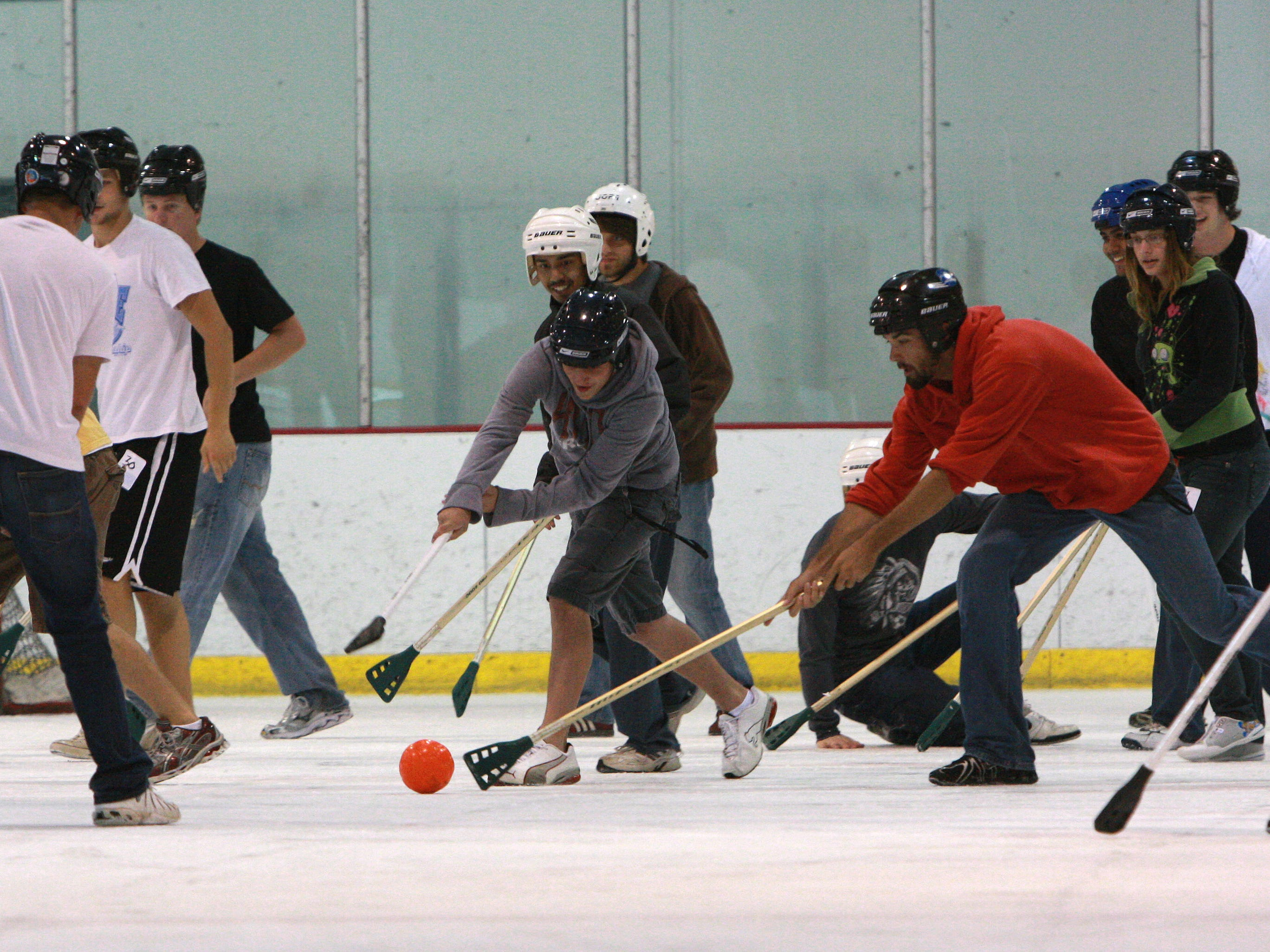 New Drury students play broomball at Mediacom Ice Park as part of a four-day orientation program.