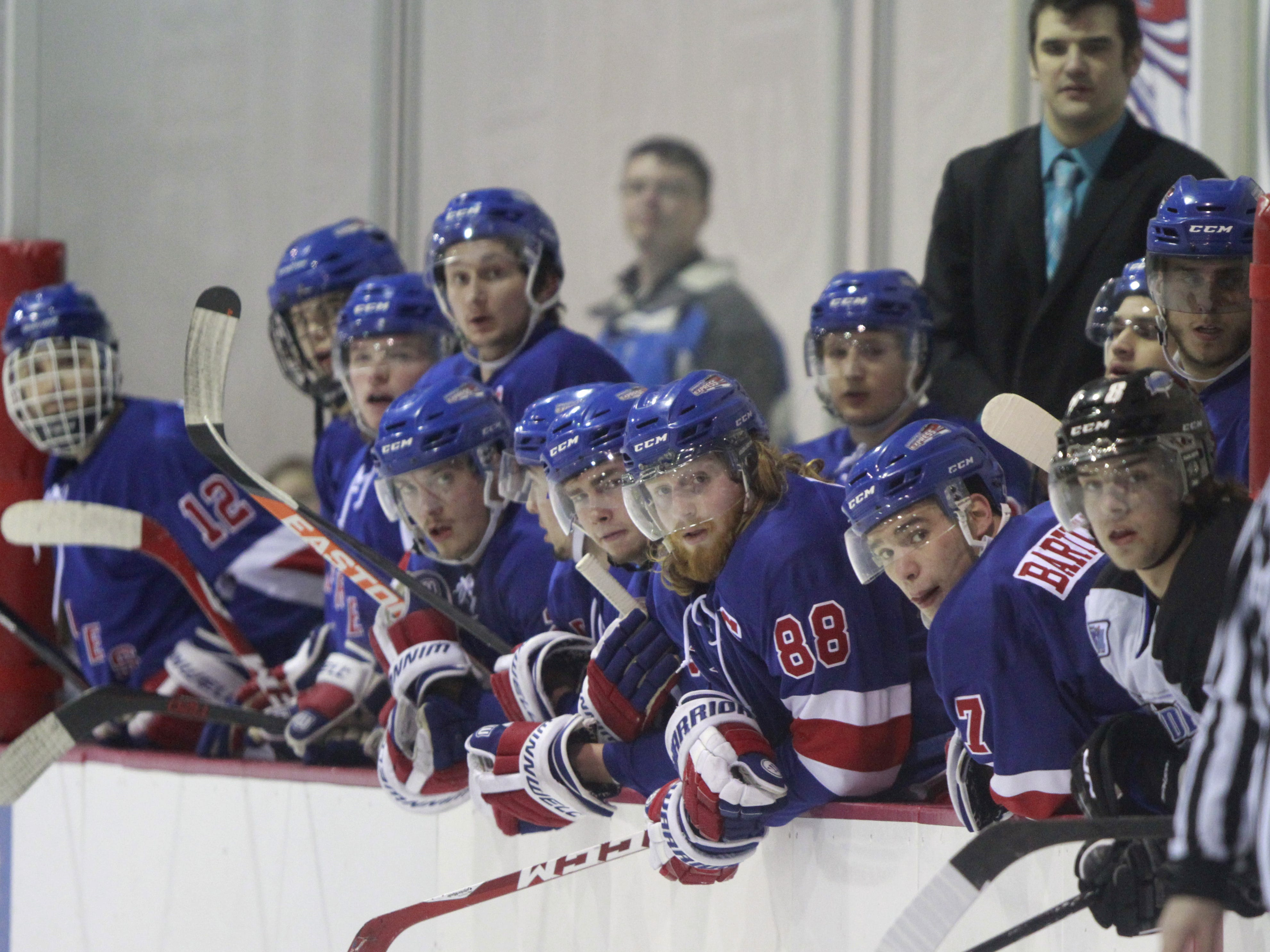 Hockey players on the Springfield Express watch from the bench during a game against the Wichita Jr. Thunder at the Mediacom Ice Park on Friday, Feb. 13, 2015.