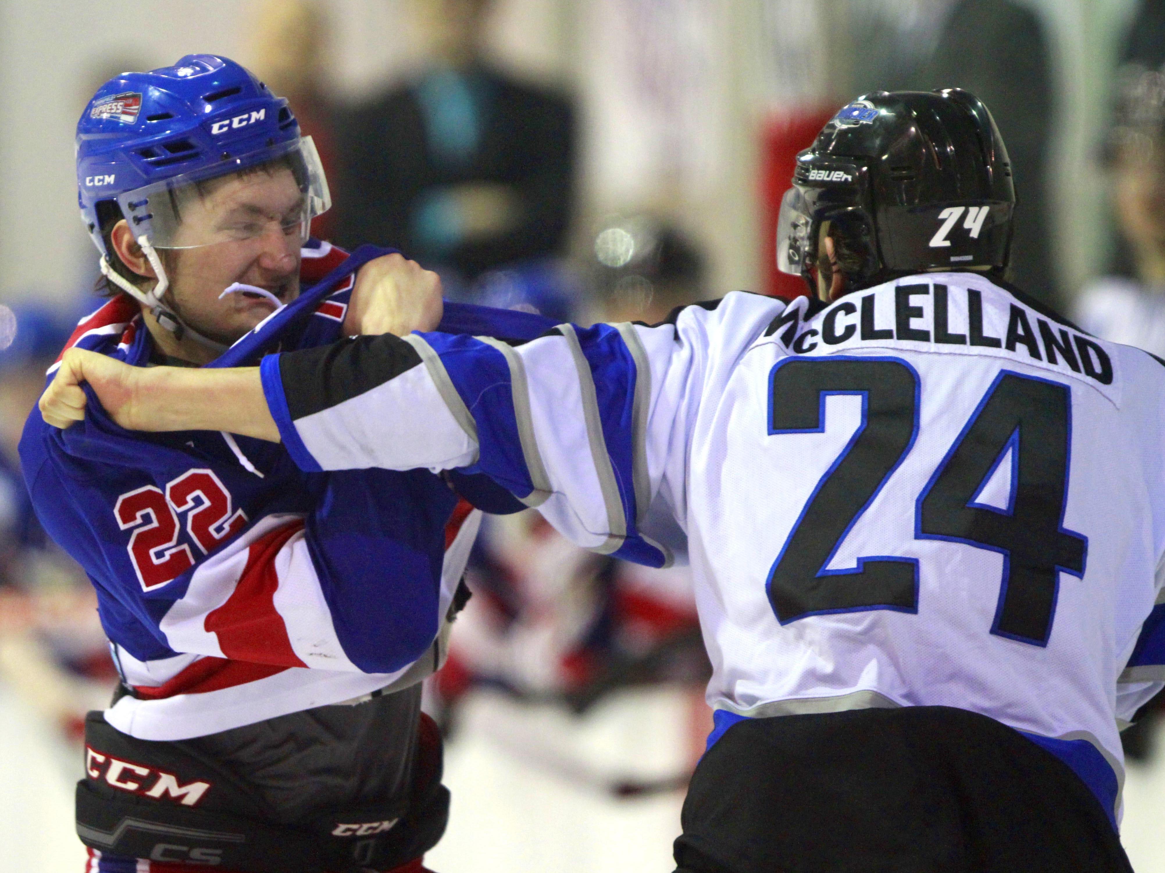 Springfield Express player David Higgs fights Wichita Jr. Thunder player Jack McClelland at the Mediacom Ice Park on Friday, Feb. 13, 2015.