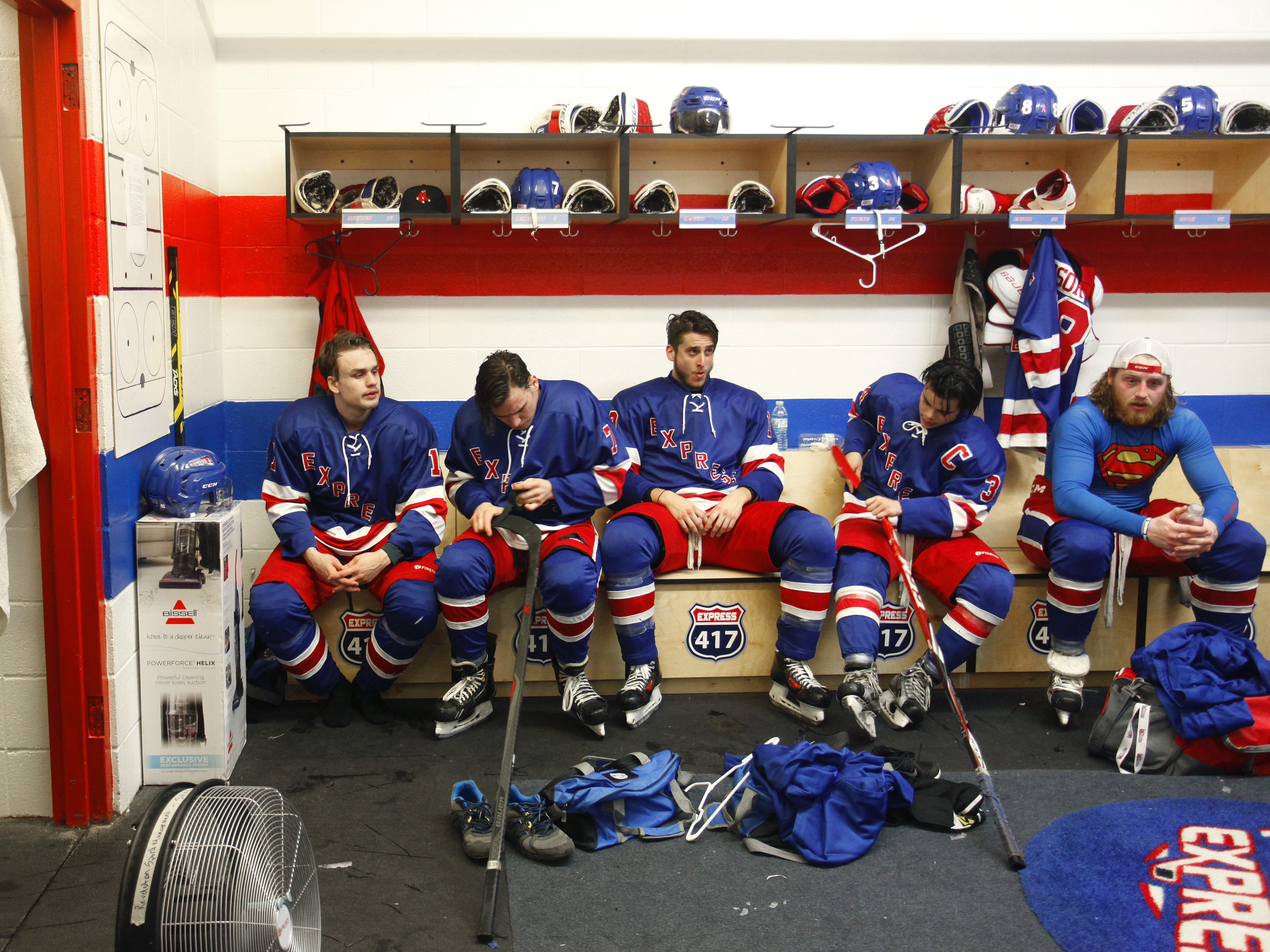 Springfield Express players (from left) Ted Astrom, Diego Bartlett, Vito DeVito, Collin Young, and Seth Ensor recover in the locker room between periods of a game against the Wichita Jr. Thunder at the Mediacom Ice Park on Friday, Feb. 13, 2015.