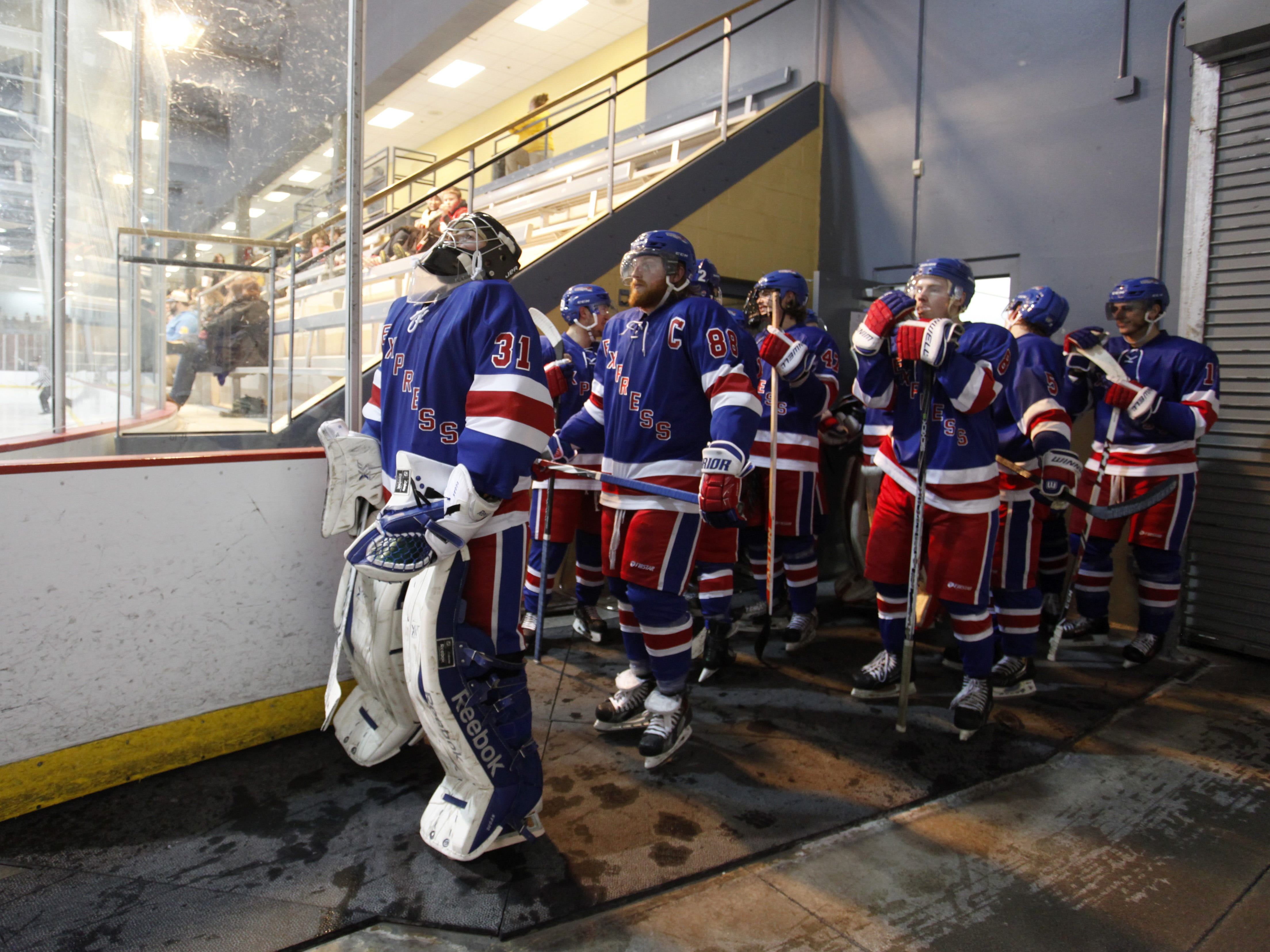 Springfield Express goalie Bobby Dugan prepares to lead the team onto the ice after for the second period during a game against the Wichita Jr. Thunder at the Mediacom Ice Park on Friday, Feb. 13, 2015.