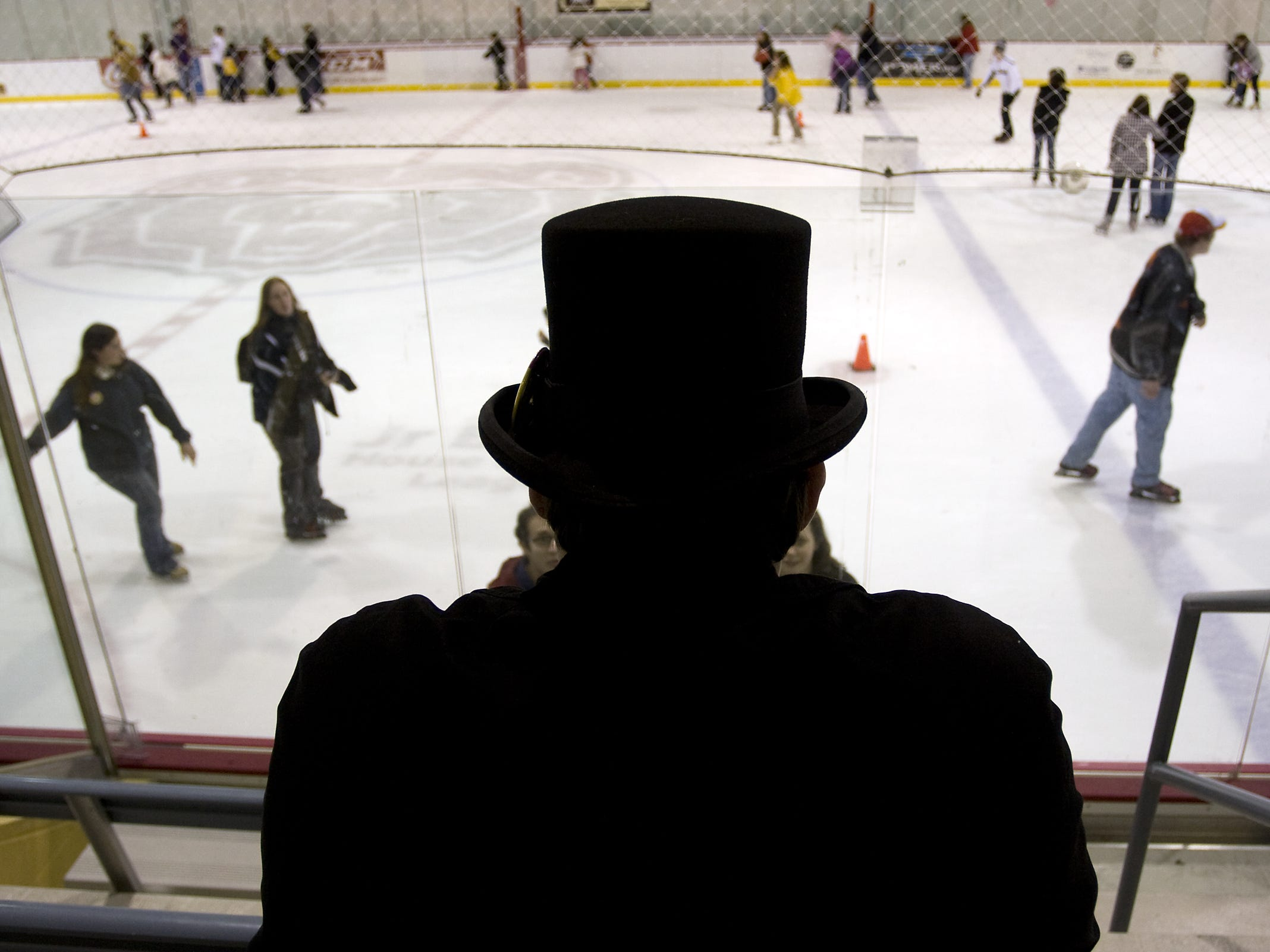 Robi Finley, center, watches as his friends and other New Year's Eve celebrants participate in an Open Ice Skate at Mediacom Ice Park during First Night Springfield 2009 on Dec. 31, 2009.