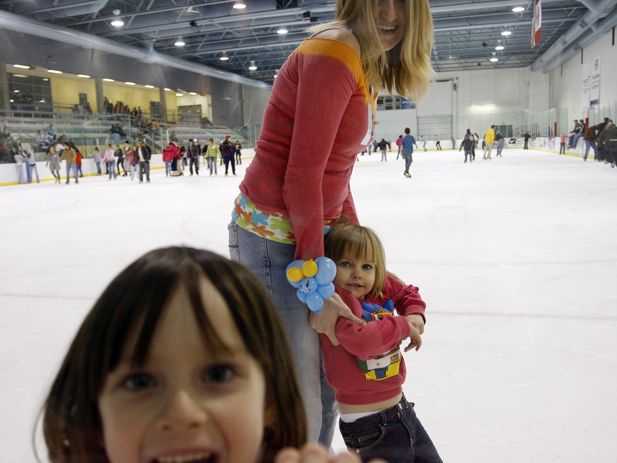 Jessica Humpan, of Springfield, top center, and her daughters, Ray Ray Humpan, right lower center, and Soya Humpan, 4, bottom left, enjoy a session of ice skating during the Open Ice Skate event of the Spotlight First Night Springfield 2009 presented by Hollywood Theaters at Mediacom Ice Park in Springfield, Missouri, Thursday, January 1, 2008.