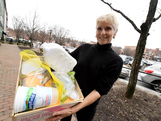 Melody Tennant of Raphine holds a box that contains the plastic produced by her household of two in December while trying to cutback on plastics. She is photographed in Staunton on Friday, January 4, 2019.
