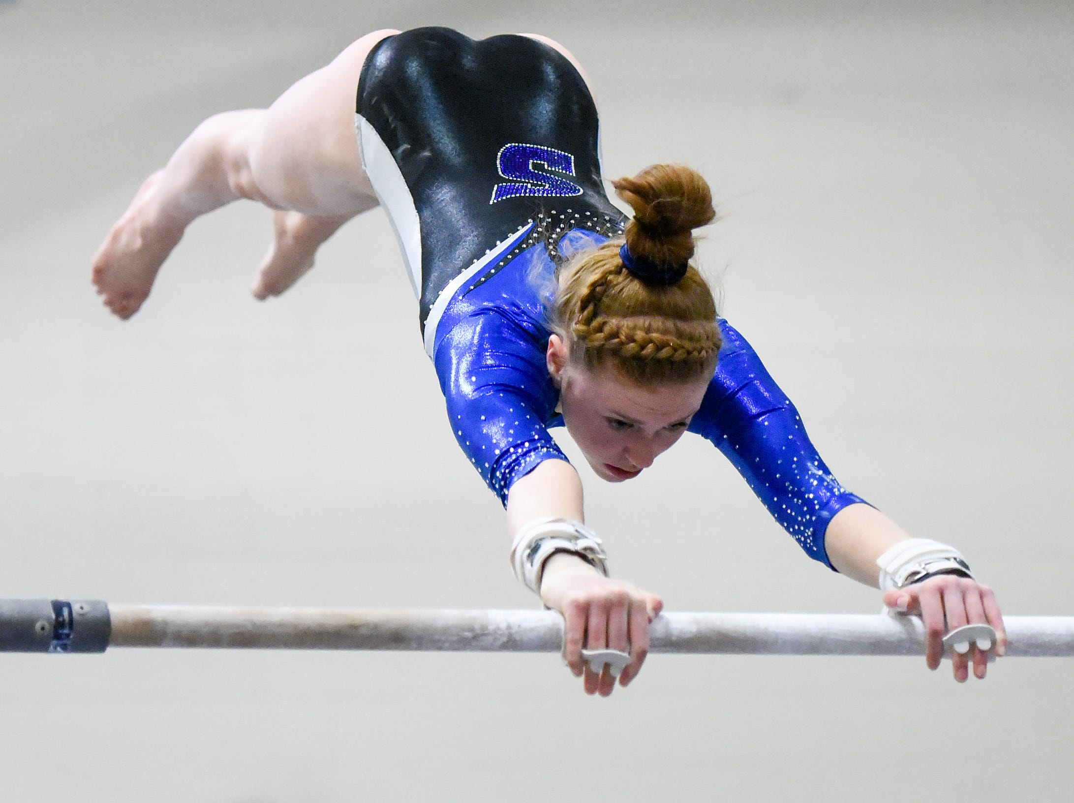 Sartell's Marlys Michaud competes on the bars Thursday, Jan. 3, at the Sauk Rapids-Rice High School.