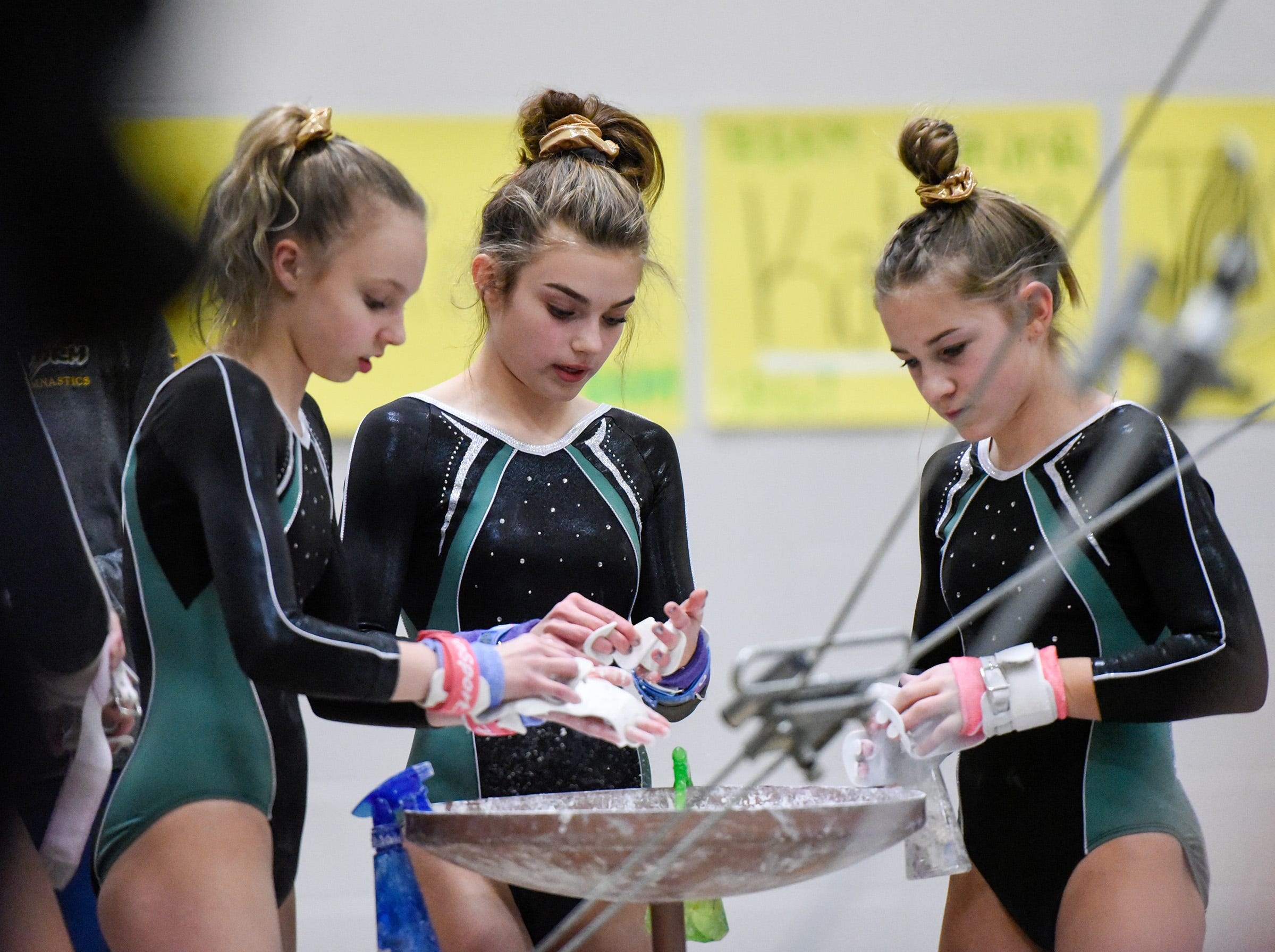 Sauk Rapids gymnasts get ready to compete on the bars Thursday, Jan. 3, at the Sauk Rapids-Rice High School.