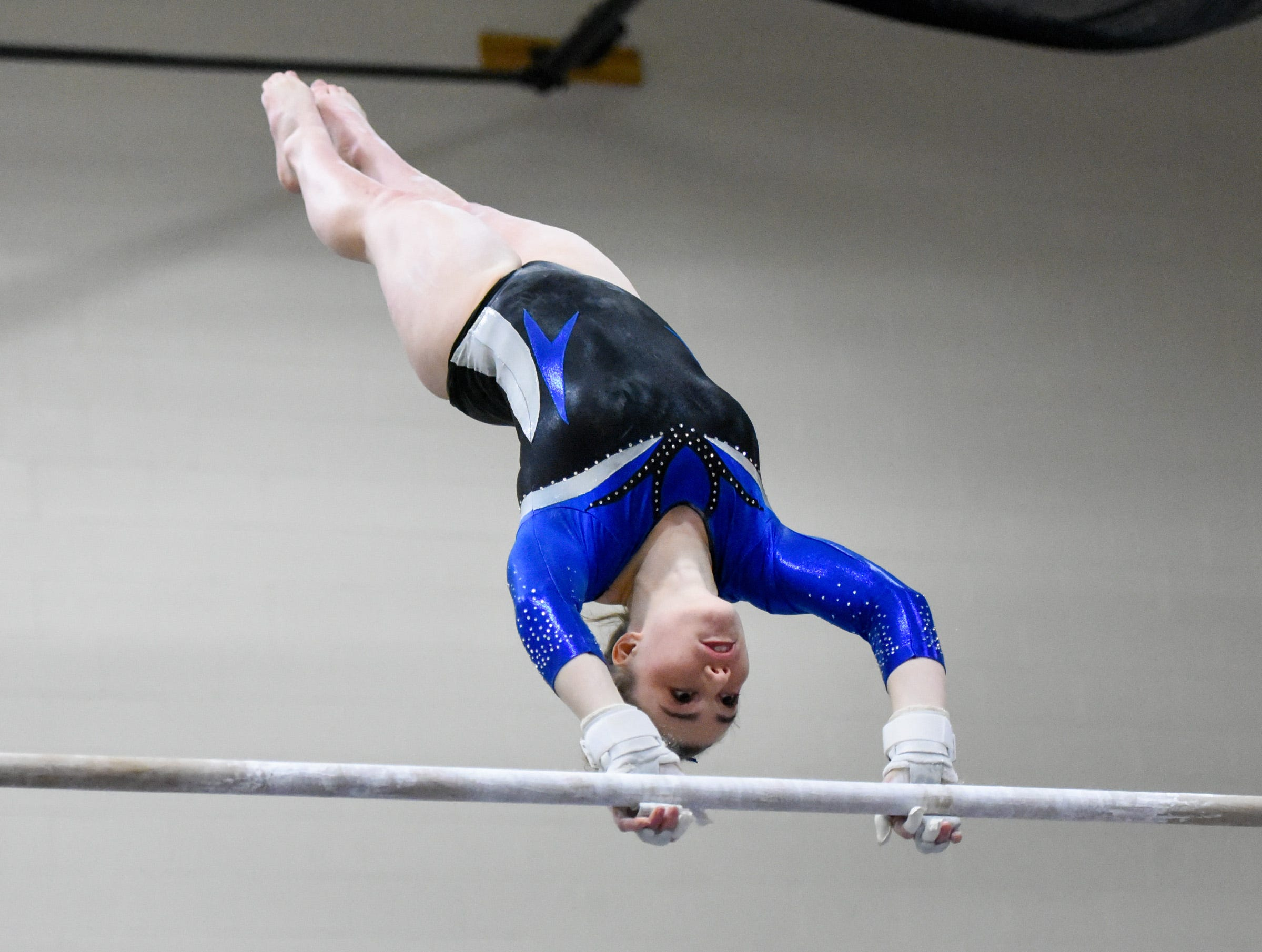 Sartell's Abigail Weber competes on the bars Thursday, Jan. 3, at the Sauk Rapids-Rice High School.