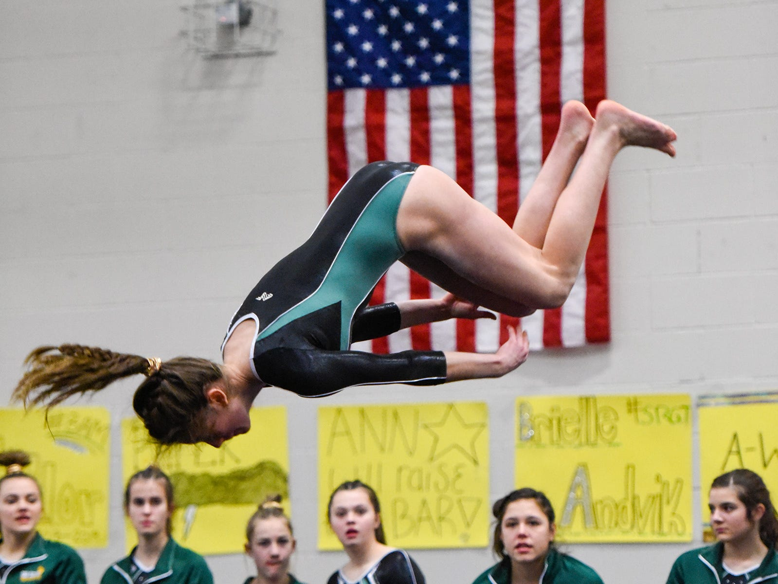 Sauk Rapids' Justus Floren does her floor routine Thursday, Jan. 3, at the Sauk Rapids-Rice High School.