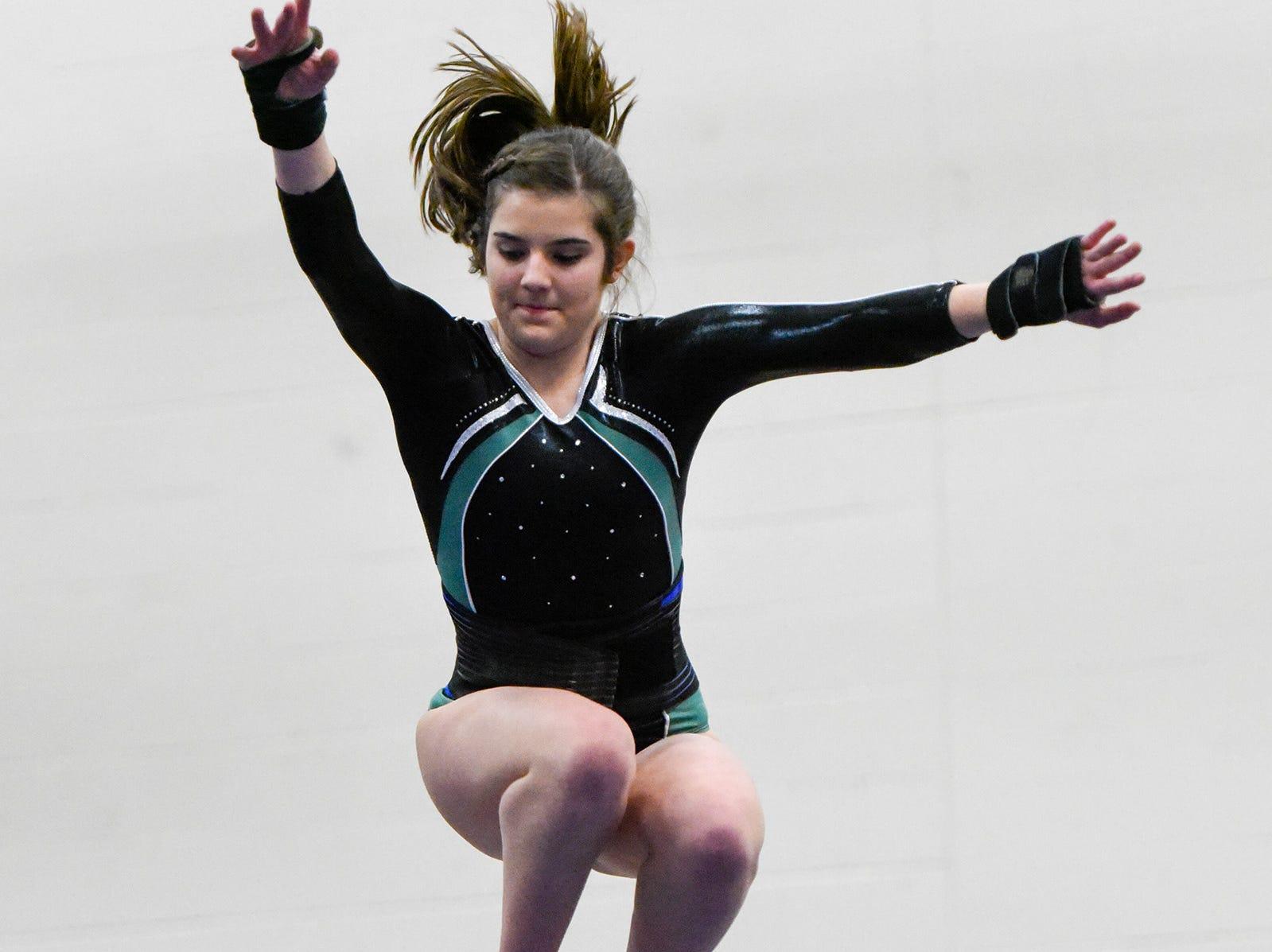 Sauk Rapids' Taylor Helget competes on the beam Thursday, Jan. 3, at the Sauk Rapids-Rice High School.