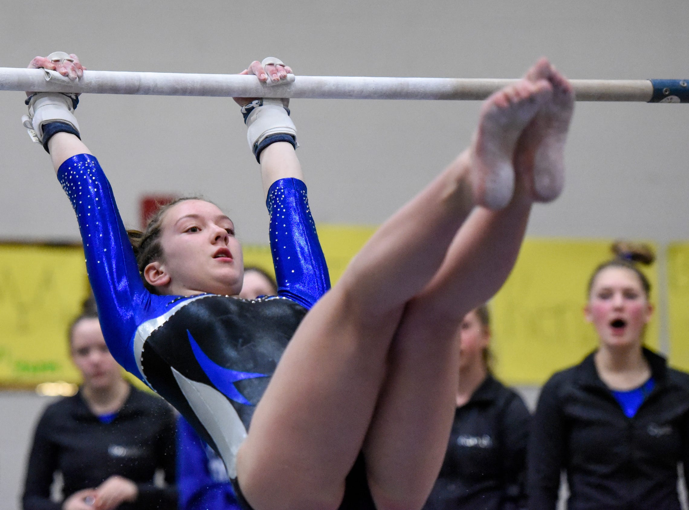 Sartell's Morgan Weber competes on the bars Thursday, Jan. 3, at the Sauk Rapids-Rice High School.