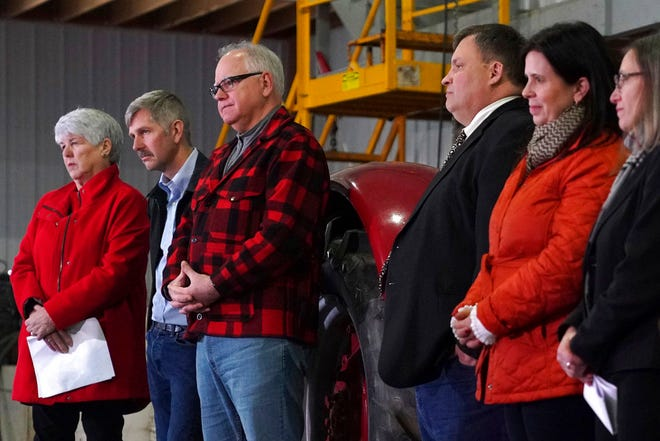 Gov.-elect Tim Walz stands with some of the seven commissioners he announced during a news conference Thursday, Jan. 3, at Bill Sorg's Dairy Farm in Hastings, Minn.