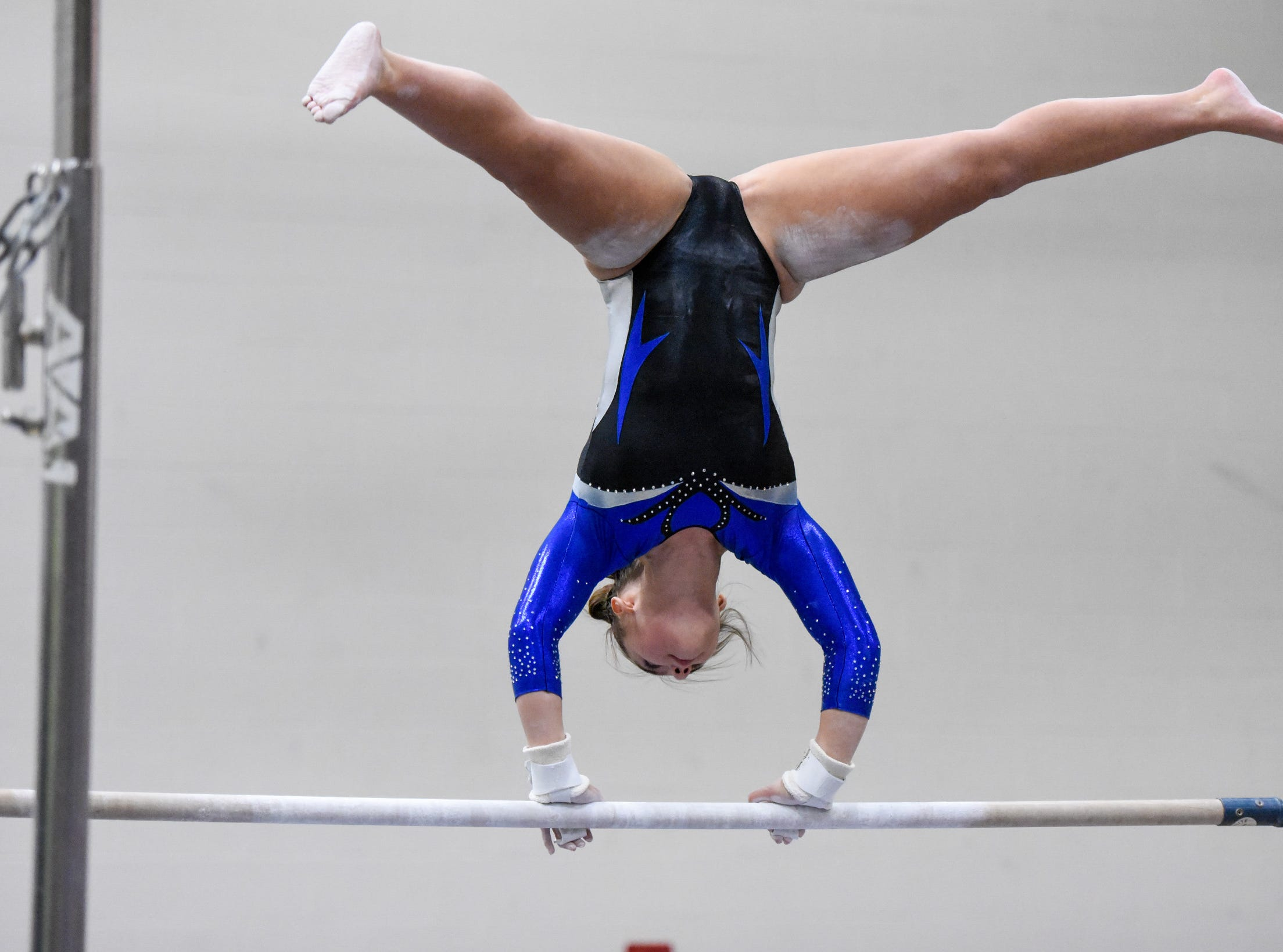 Sartell's Carley Yang competes on the bars Thursday, Jan. 3, at the Sauk Rapids-Rice High School.
